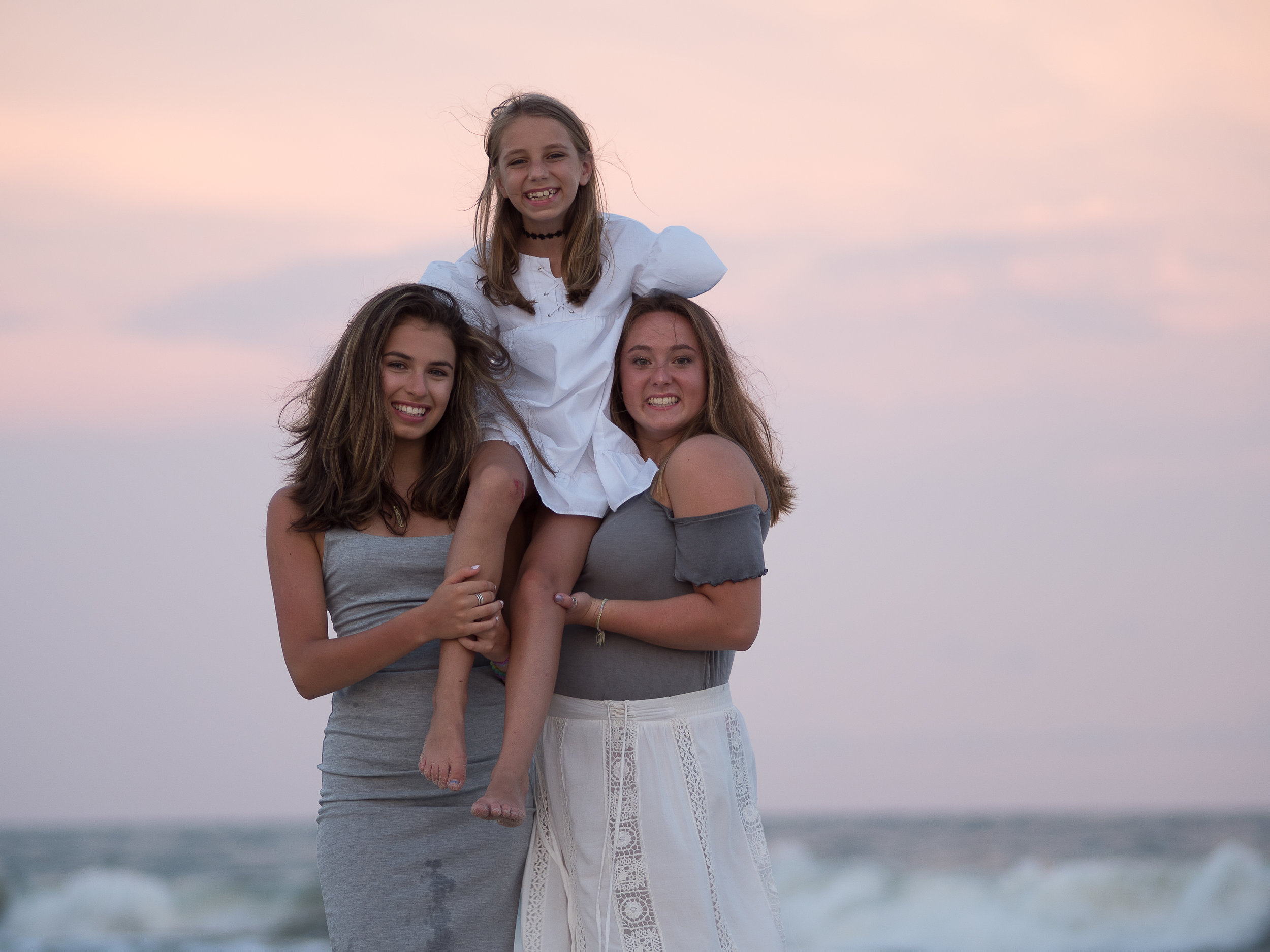 - Cousins at the beach with ocean in background. Ocean Isle Beach, NC.