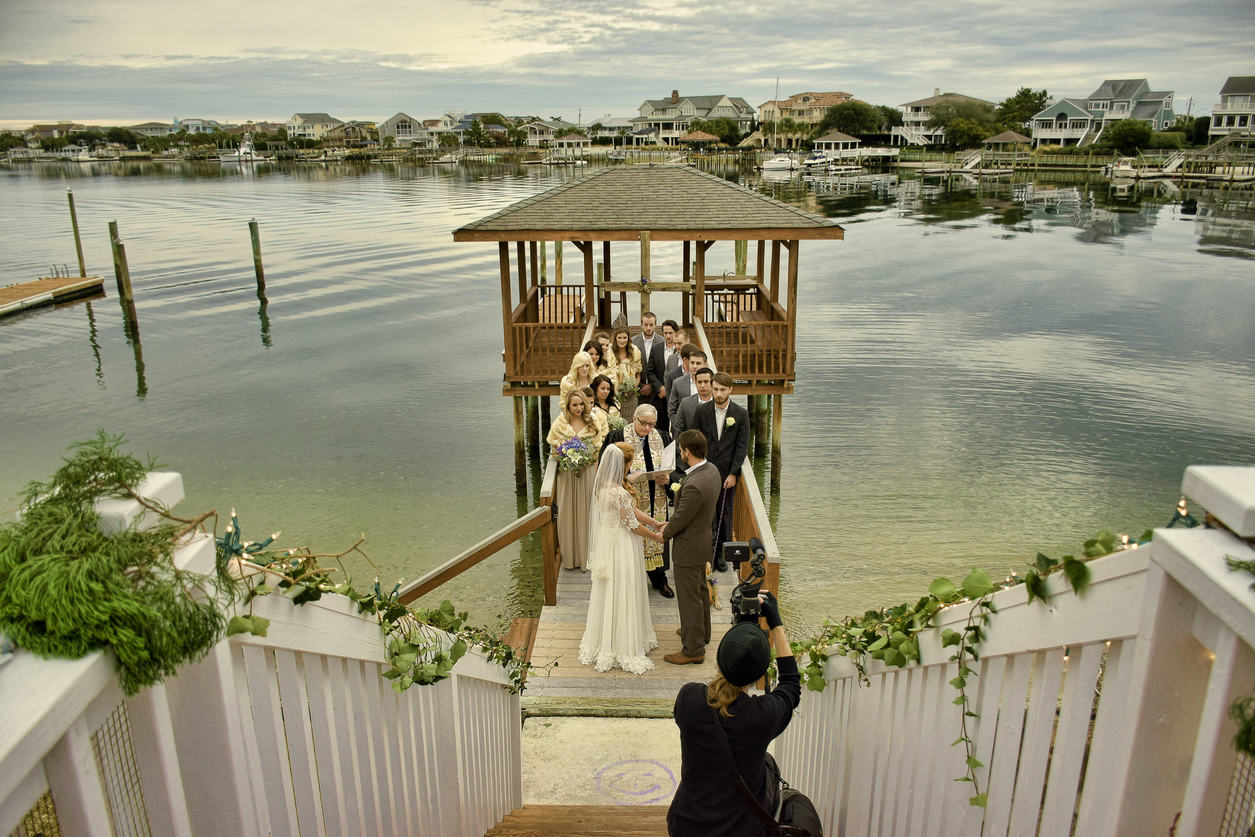 - Wide angle shot of the wedding ceremony. Wrightsville Beach, NC.