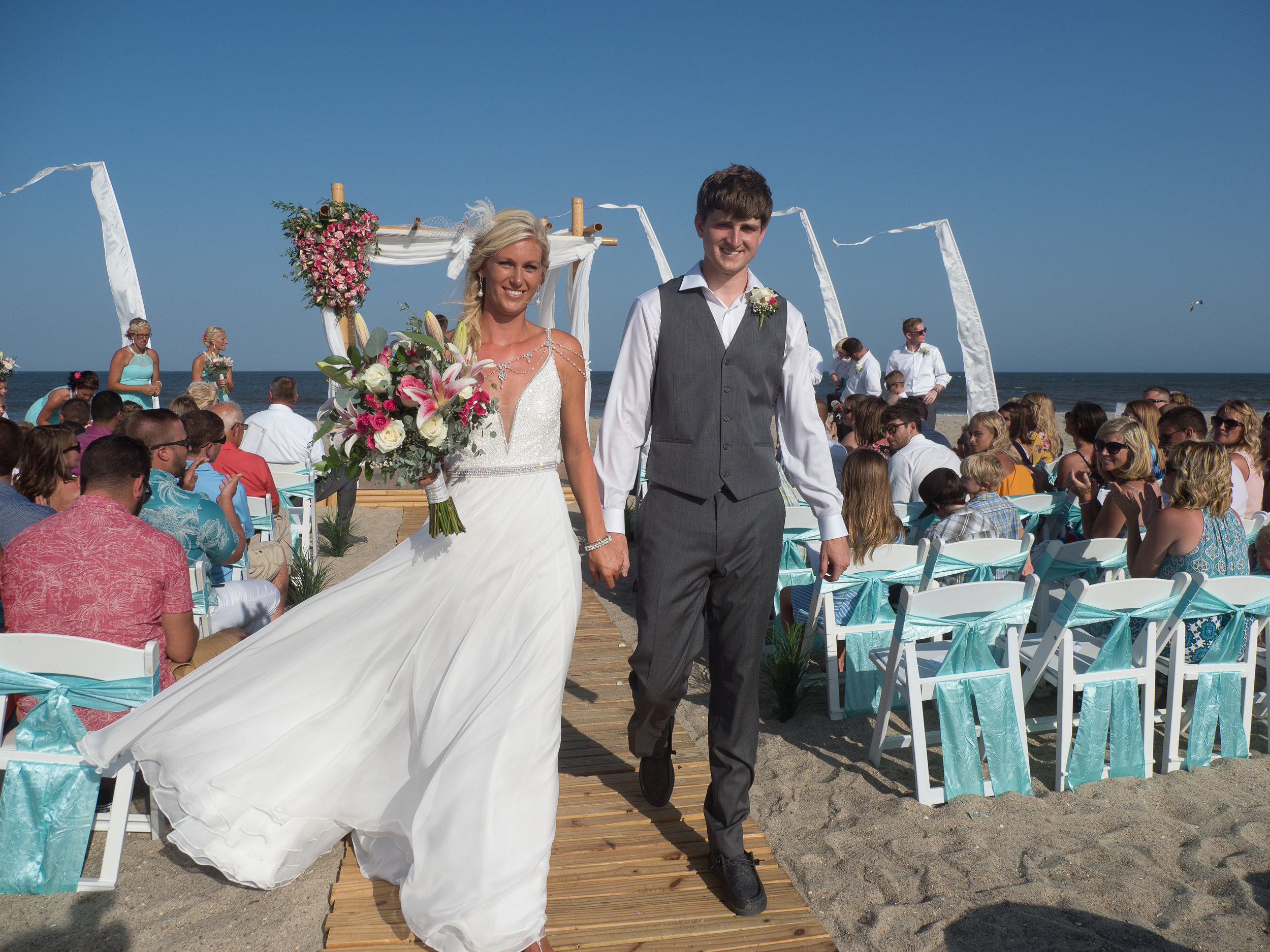 - Bride and groom walking up the aisle after being pronounced