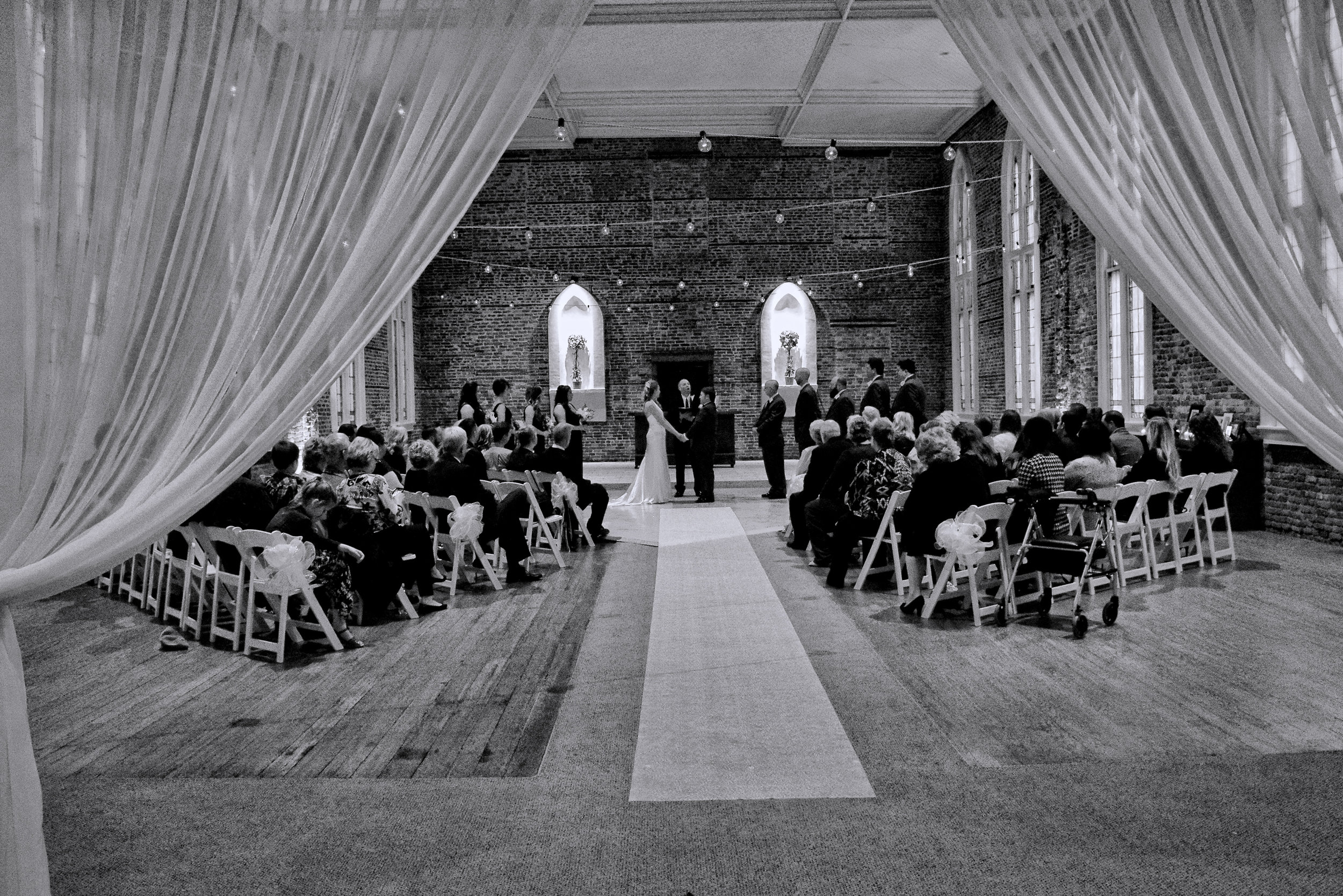 - Wedding Ceremony at Saint Thomas Preservation Hall in Wilmington, NC. Monochrome. Love the curtains. Billy Beach Photography.