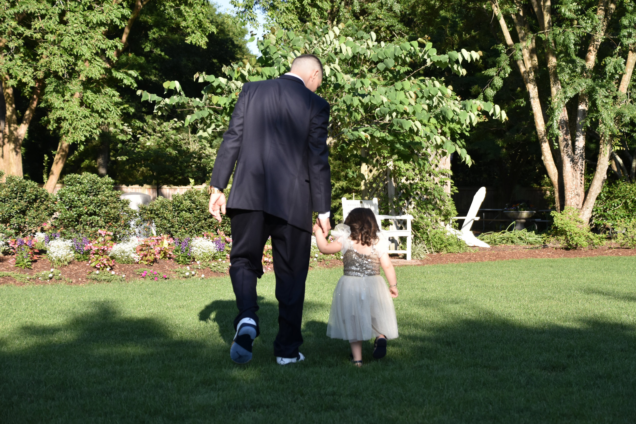 Walk. - After the wedding we went to the Arboretum to do some pictures. This is the groom walking with the flower girl. Wilmington, NC.