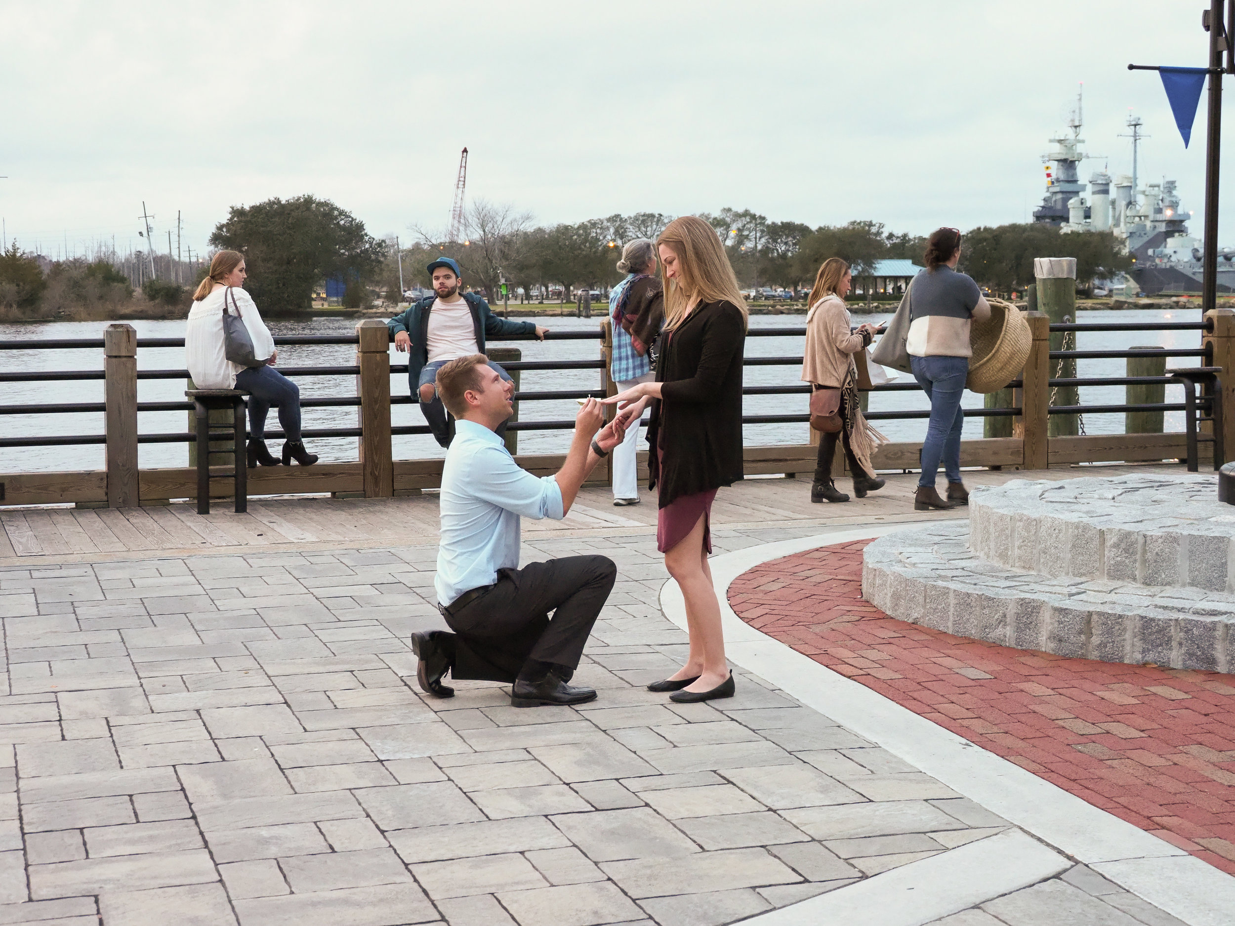 Propose - Placing the ring on her finger. Wilmington, NC Riverwalk.