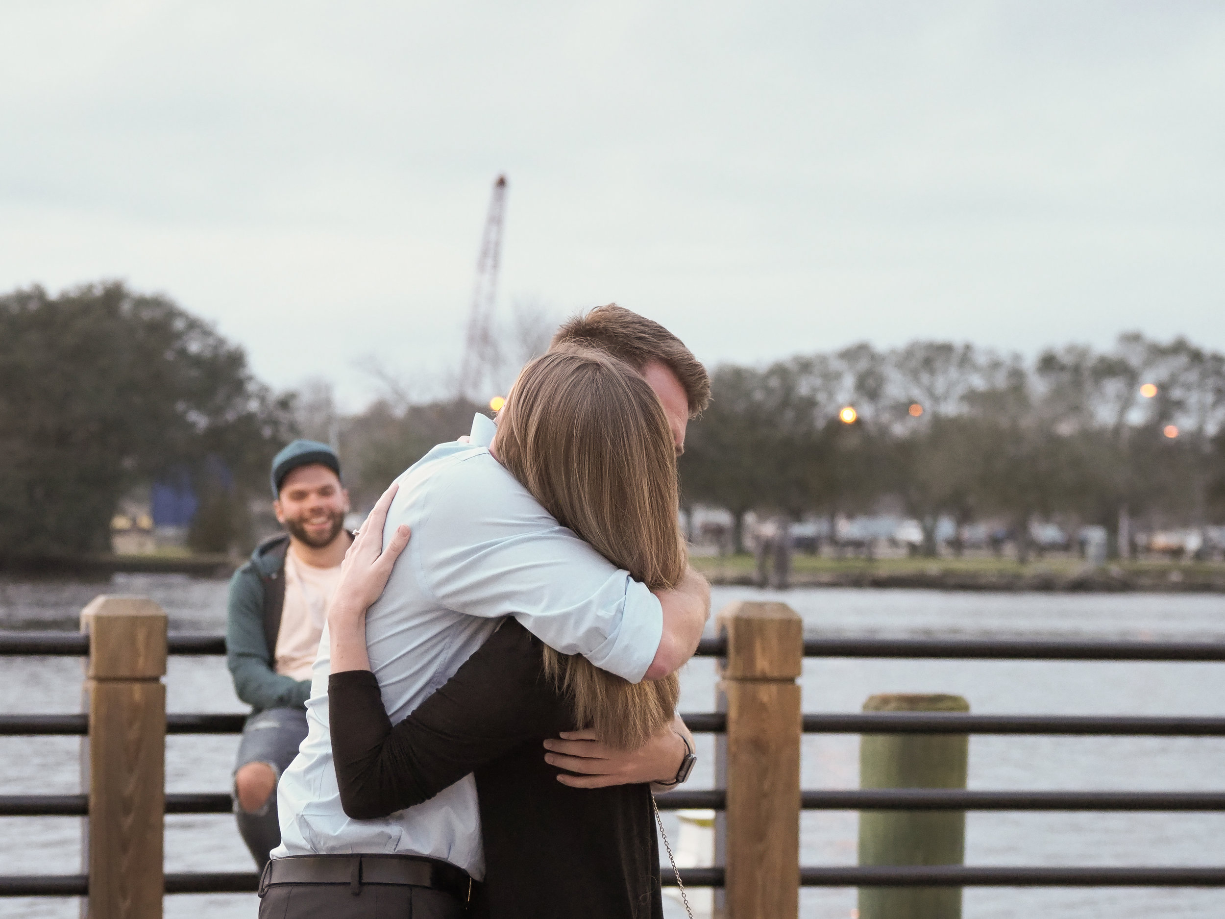 Hug. - Shear joy, as they realized that a wedding was in their future.