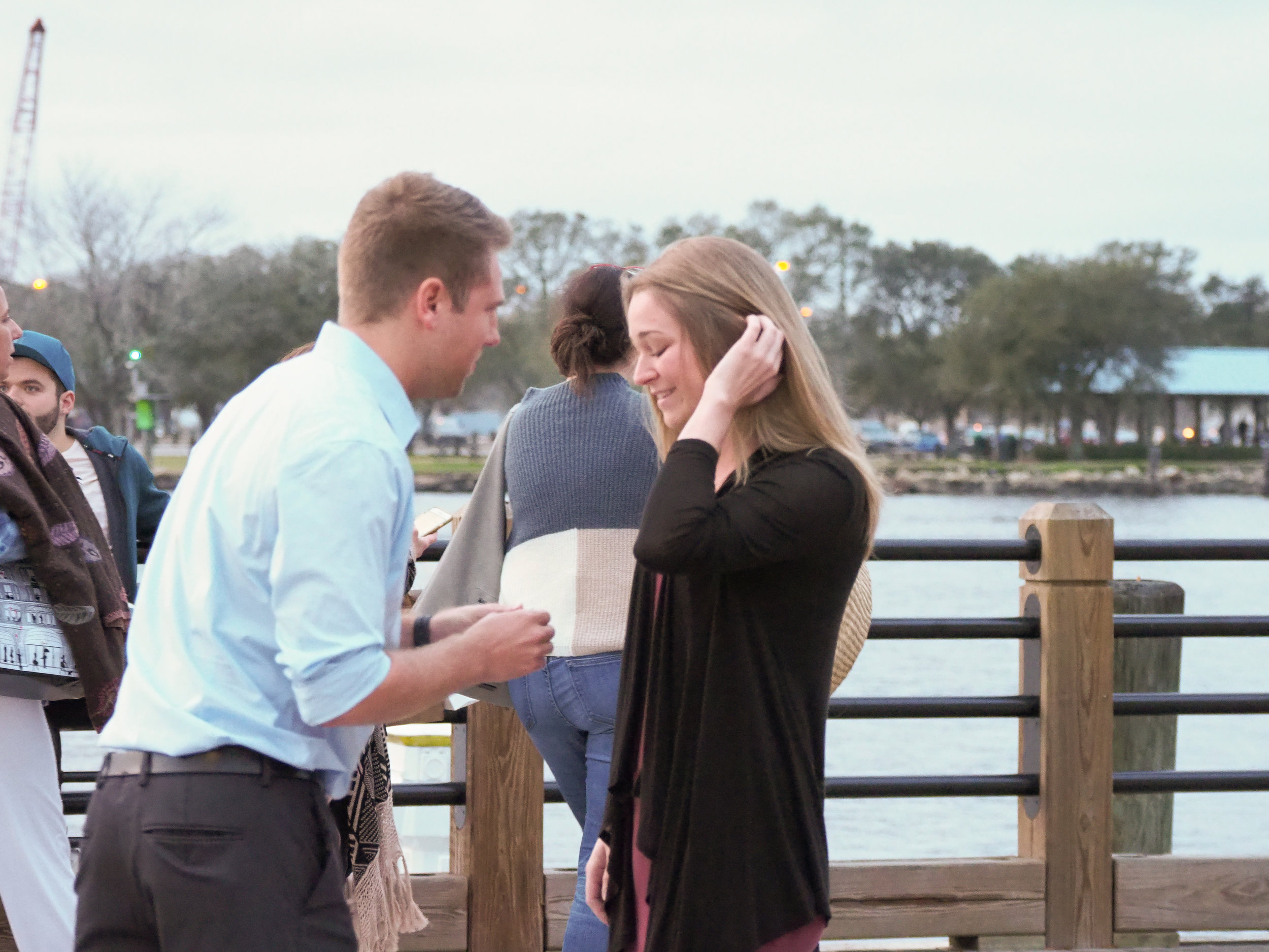The Ring. - He pulls the ring out on the Riverwalk in Wilmington, NC.