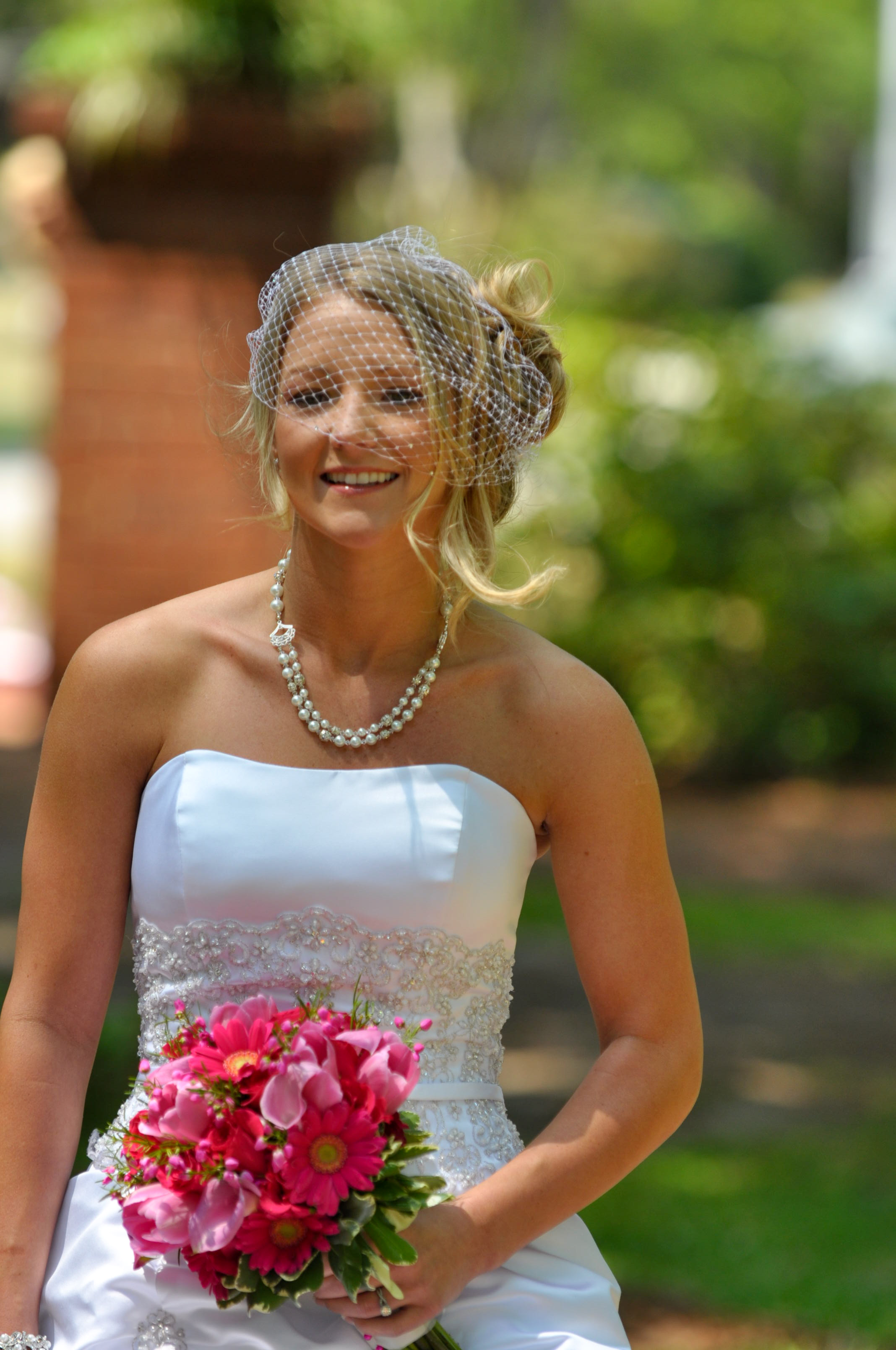 - Bride sees her groom for the first time at her wedding in Greenfield Lake, in Wilmington, NC. Big smile. Billy Beach Photography. Affordable wedding.