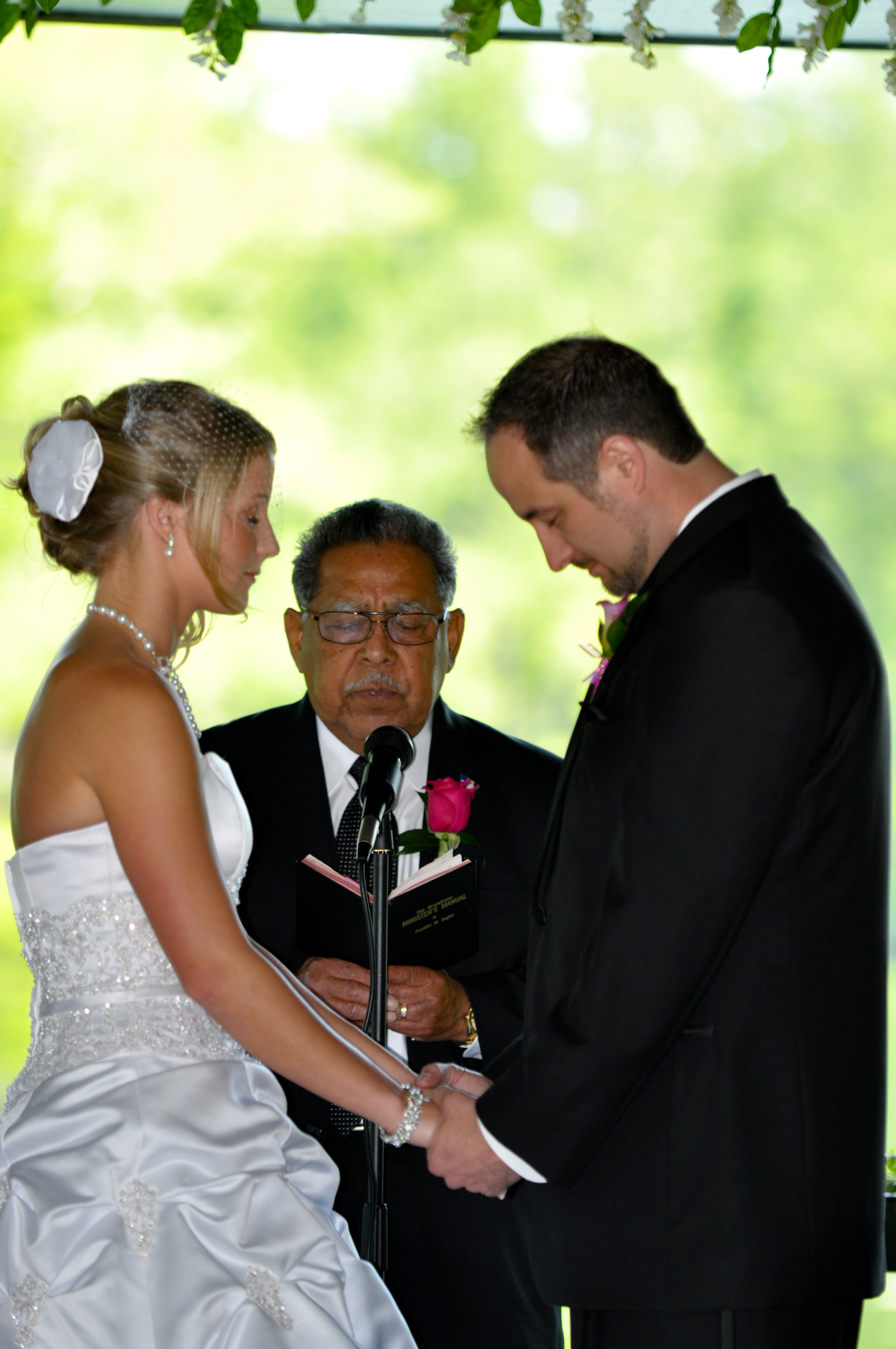 - A prayer before the vows at the Fragrance Garden in Greenfield Lake, Wilmington, NC. Billy Beach Photography. Affordable wedding.