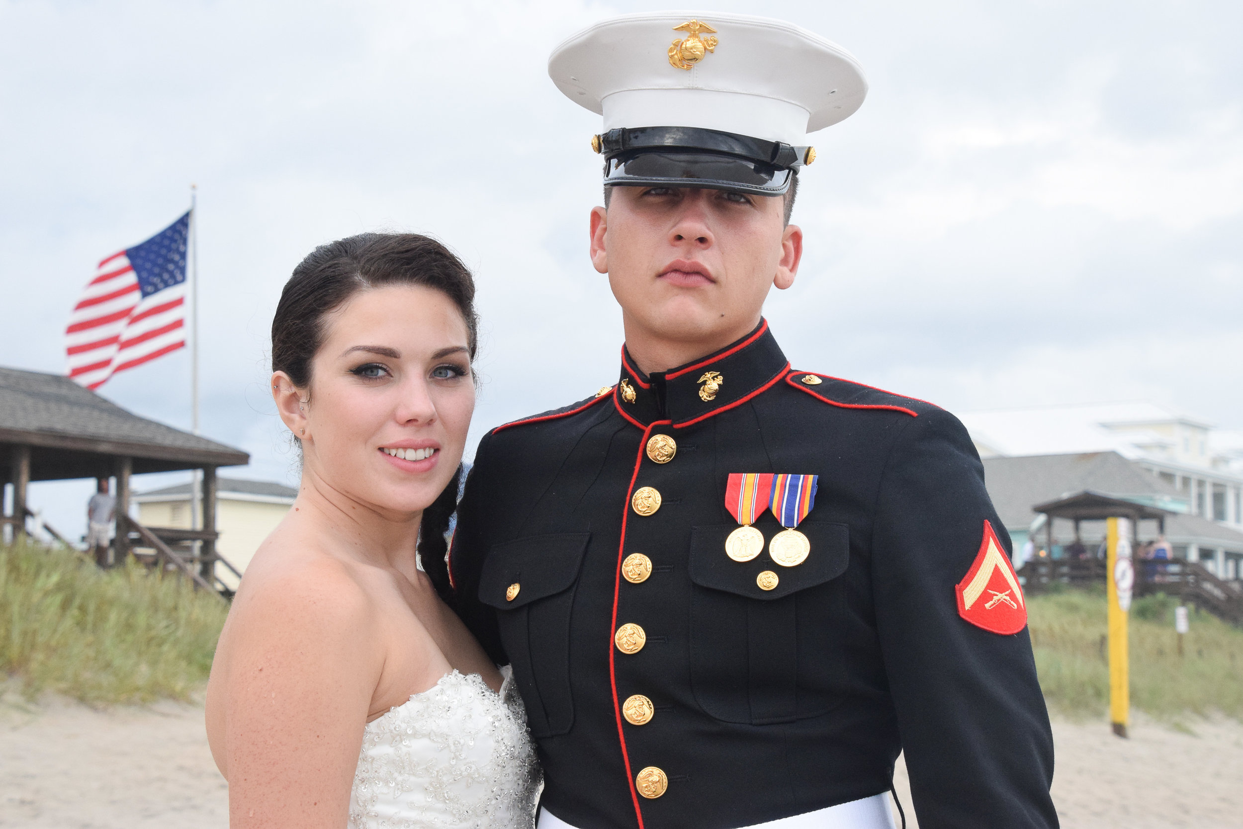 - Bride and groom post ceremony, near the Surf Center in Surf City, Topsail Beach, NC.