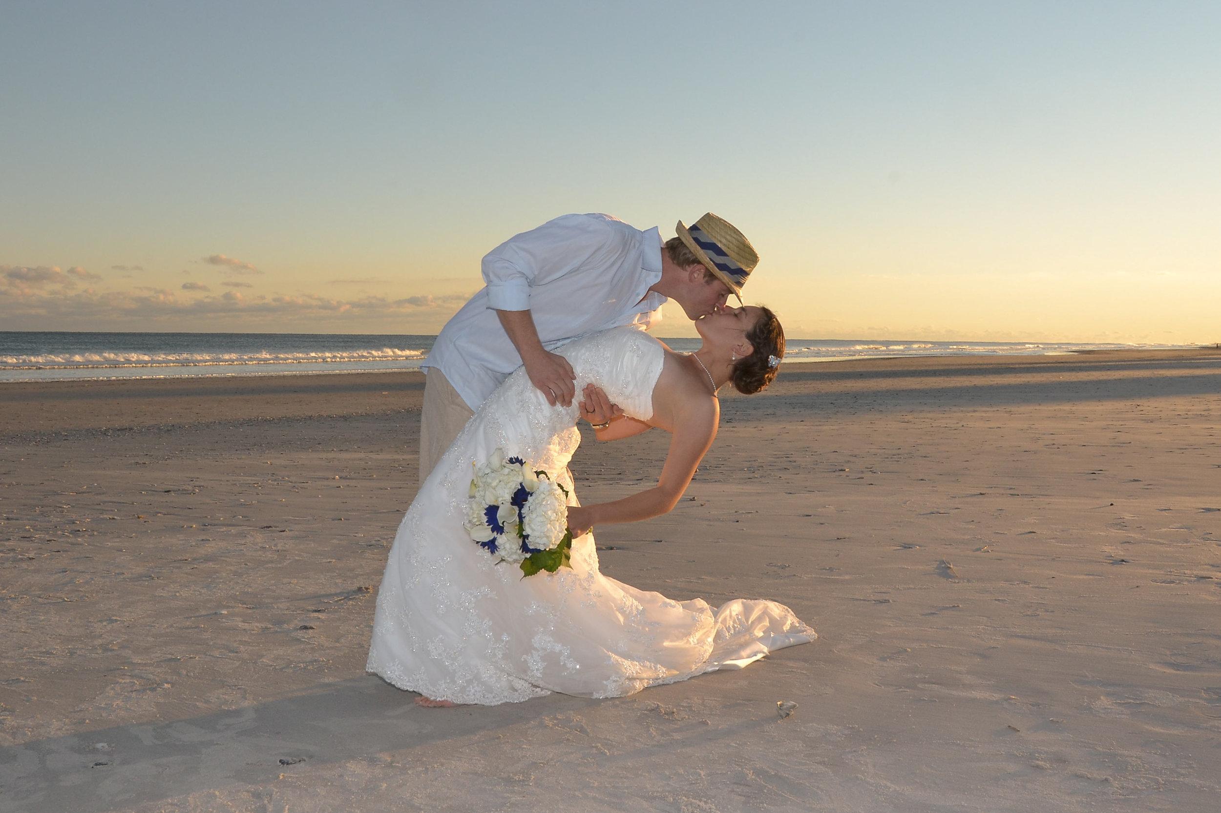 - Groom dipping his bride on Topsail Beach, NC. Beautiful Beach. Billy Beach Photography.
