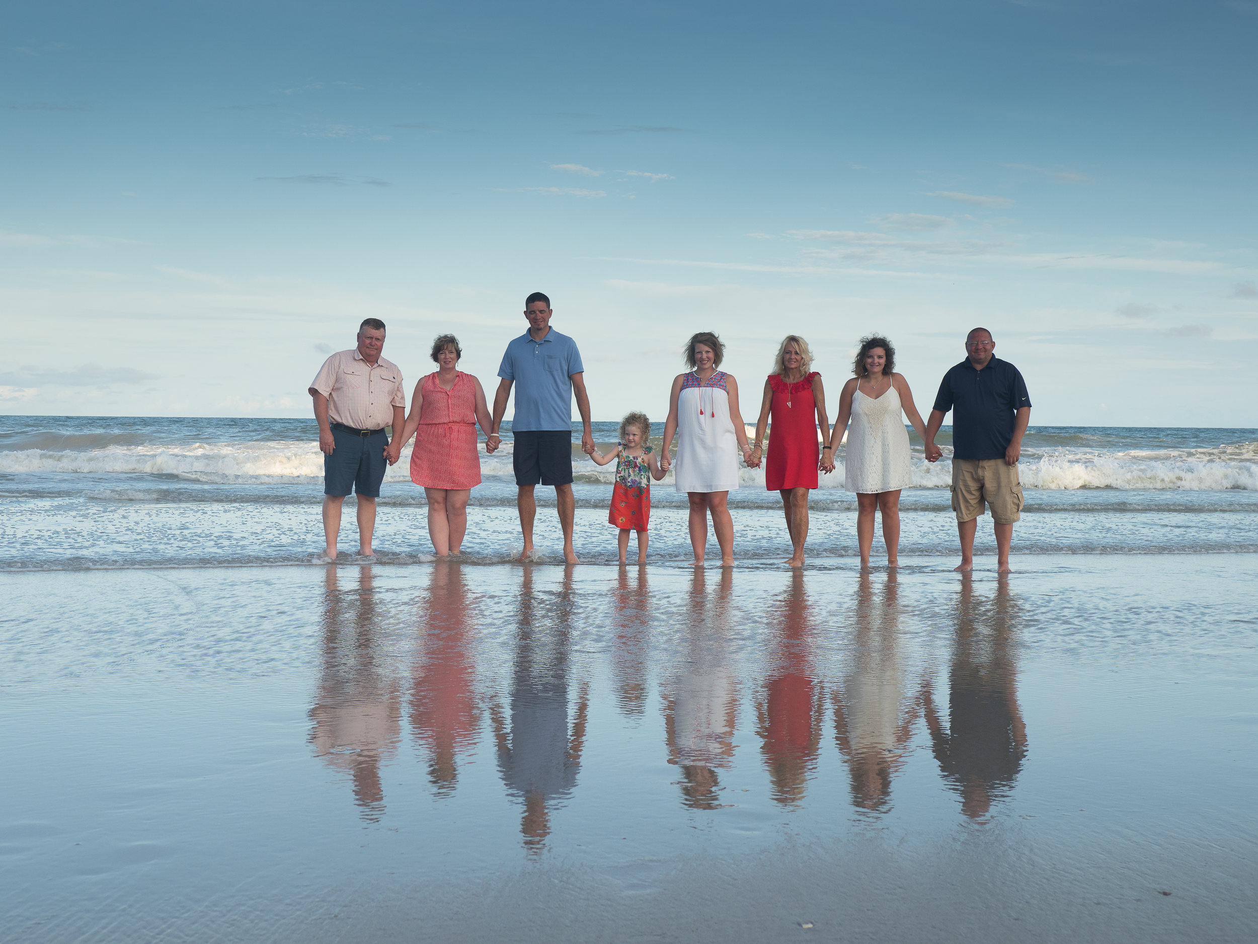 - Family at Topsail. Love the reflections on the water.