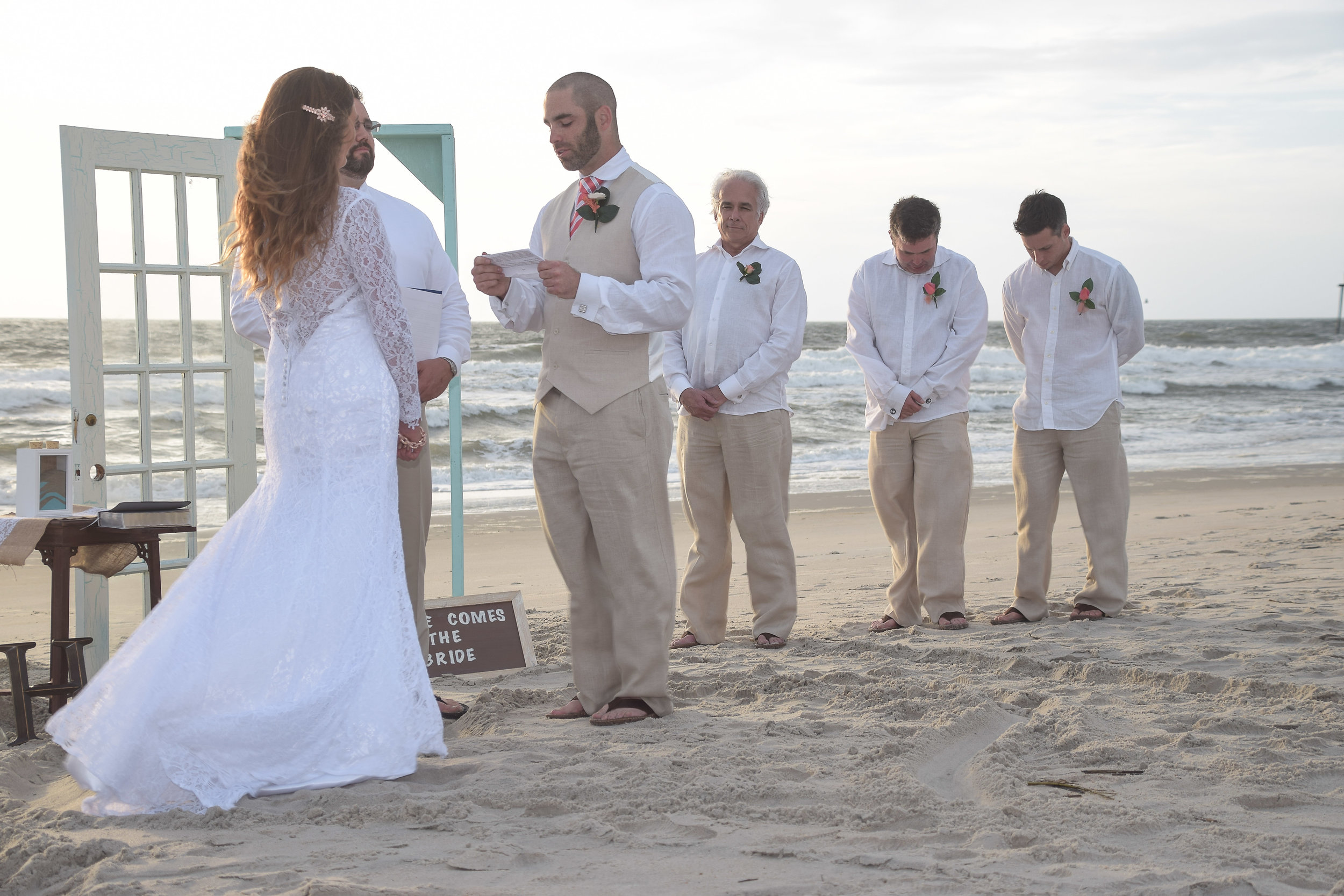 Vows. - Reciting vows at a sunrise wedding in Carolina Beach, NC. Billy Beach Photography.