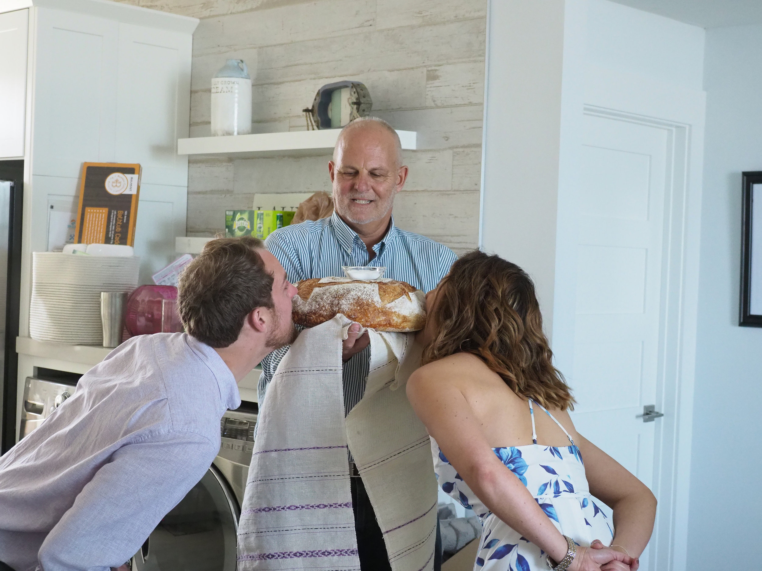 Bread - Couple partakes in Russian tradition of biting bread. Whoever takes the biggest bite will have the upper hand in the marriage the tradition goes. Who needs cake? Wrightsville Beach, NC.