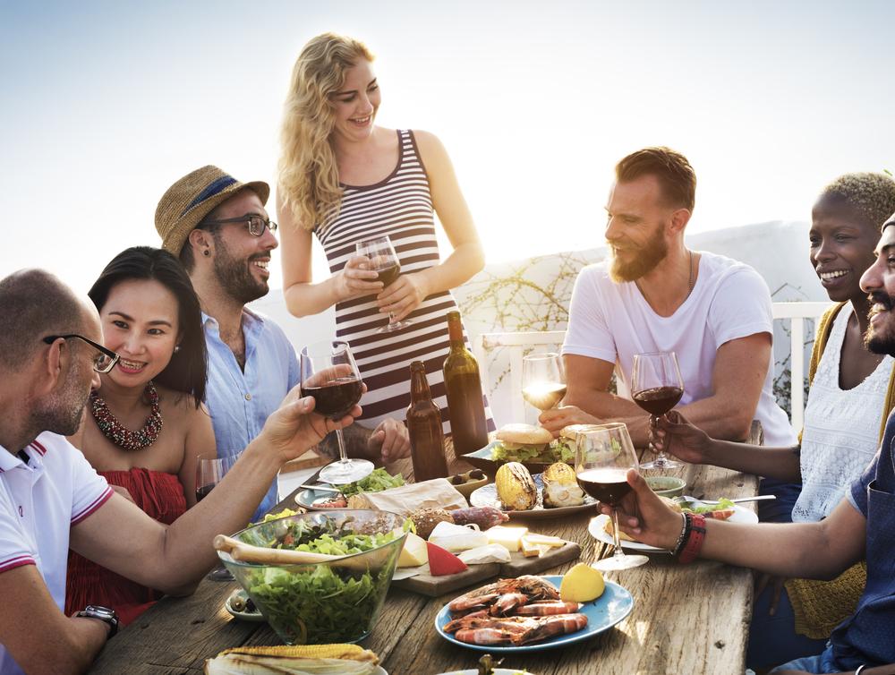 group-people-networking-drinking-in-sun-talking-business.jpg
