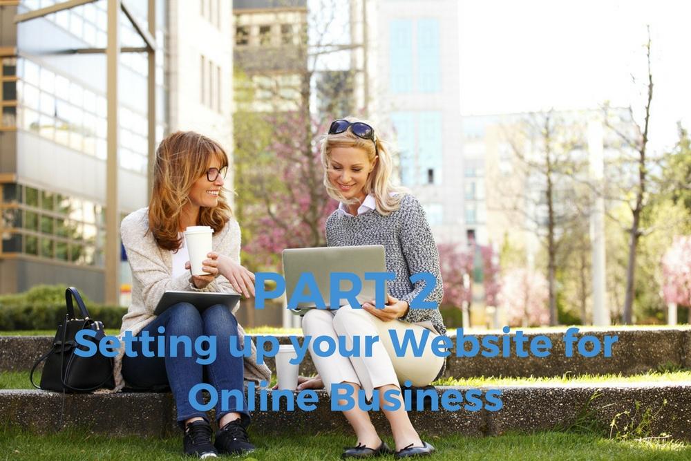 teo-women-sitting-in-park-working-website-business-on-laptop.jpg