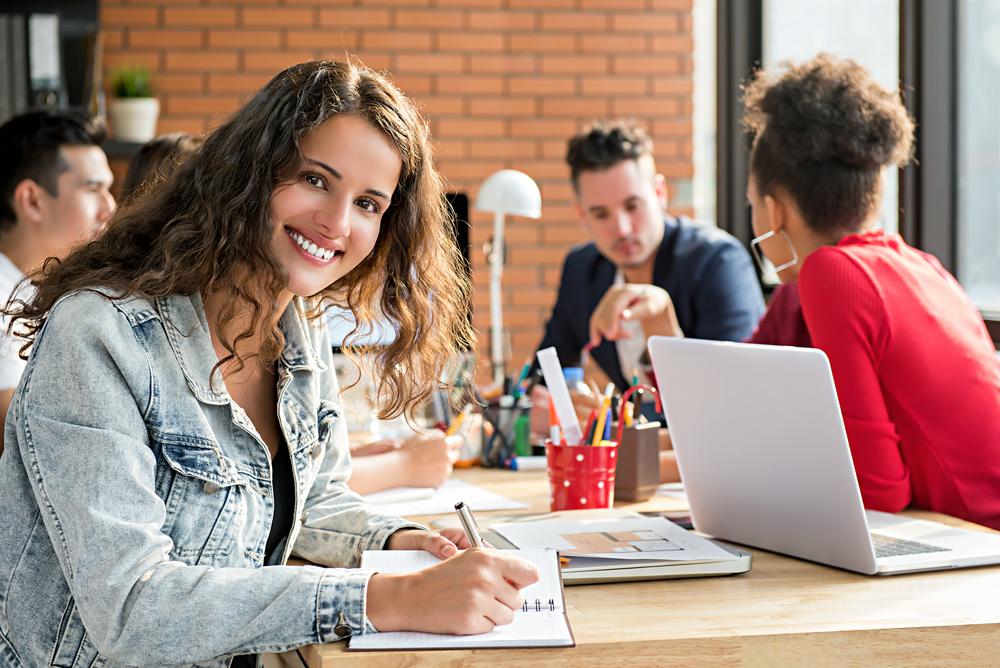 happy-woman-learning-in-workshop-on-laptop.jpg