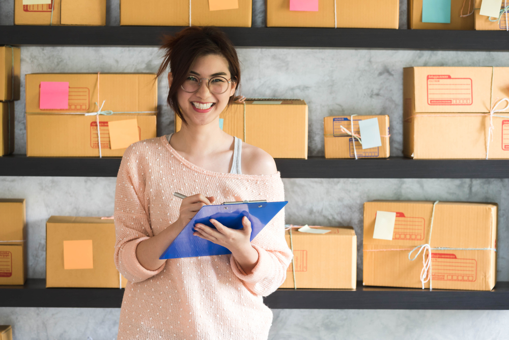girl-labelling-boxes-for-ecommerce-sales-in-office.jpg