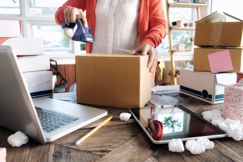 girl-packing-commerce-box-orders-for-shipping-in-office.jpg