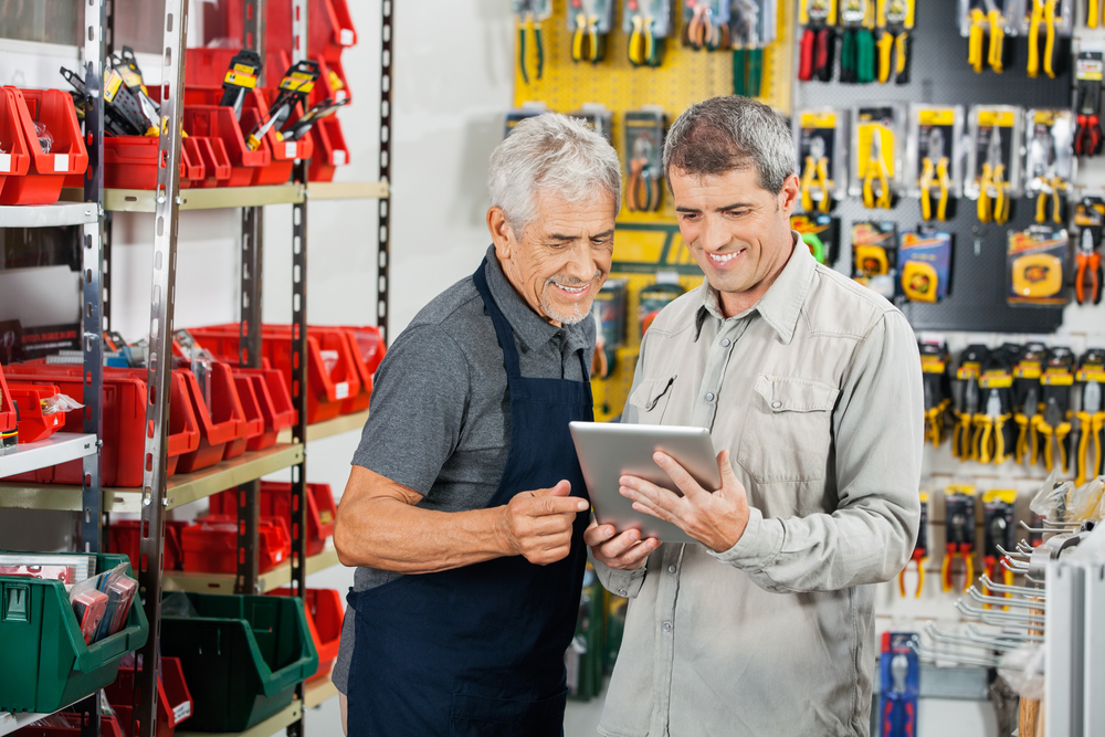 two-men-in-hardware-shop-learning-to-sell-online-on-ipad-in-store.jpg