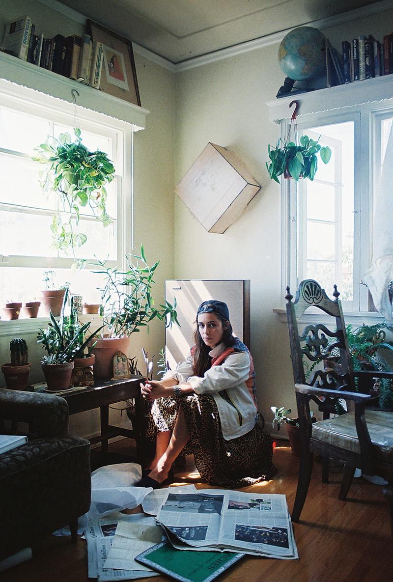 Lola in apartment by speaker.jpg