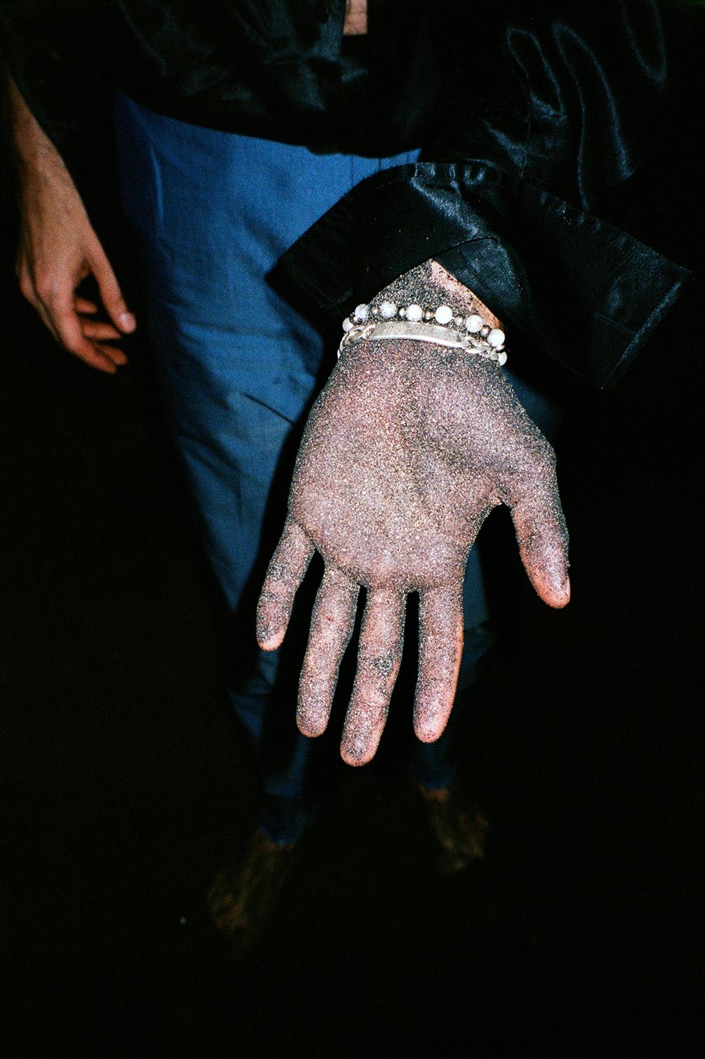 Chris hand covered in black sand_00038.jpg