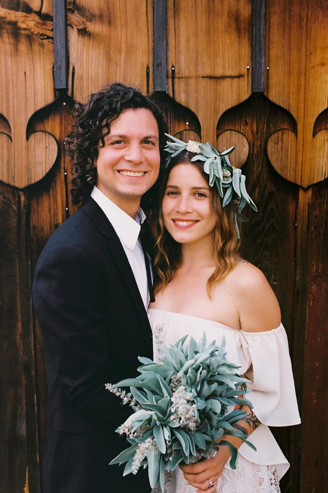 Miller and Renee portrait  wood wall.jpg
