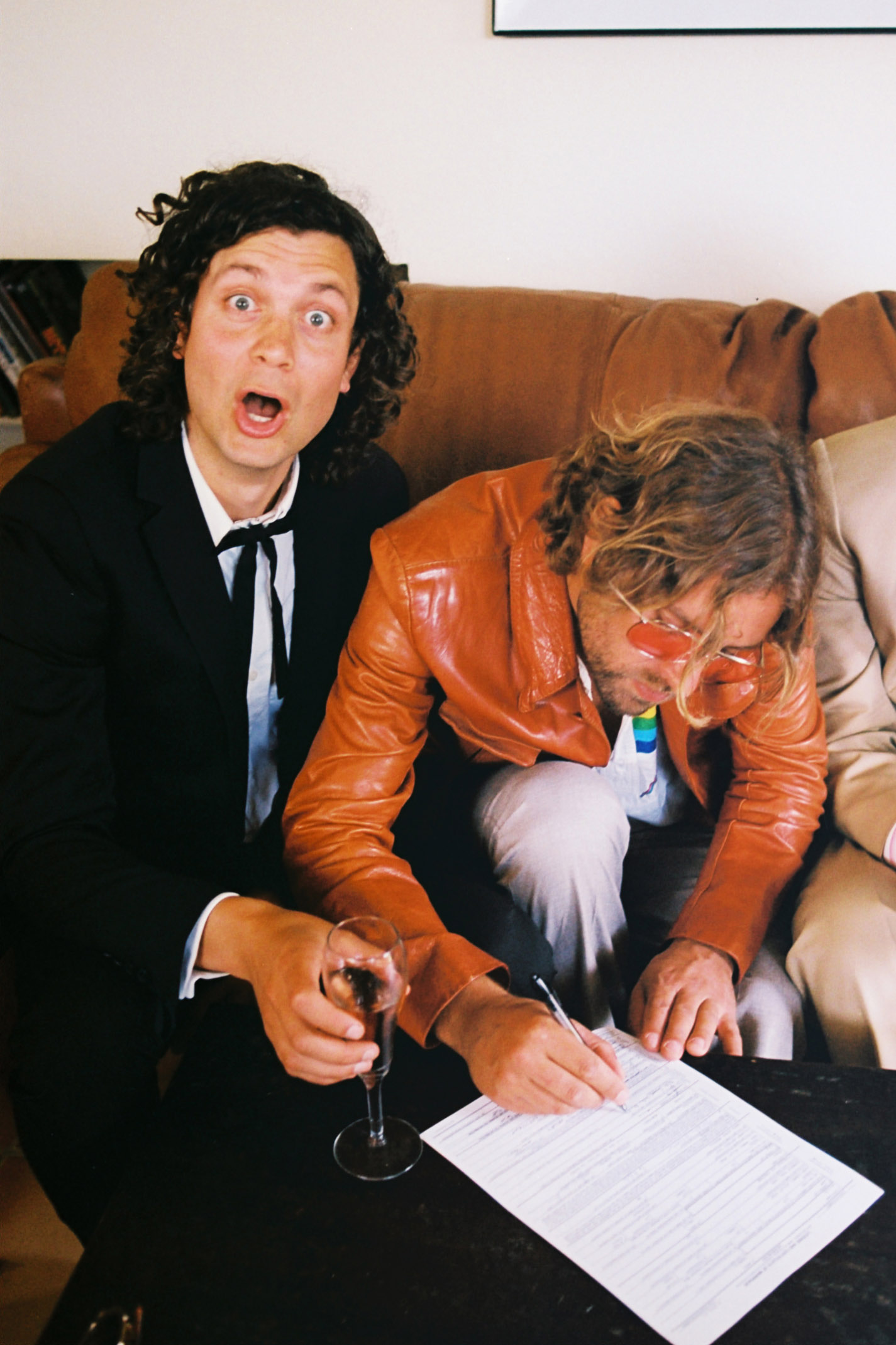 Miller and Nico signing papers.jpg