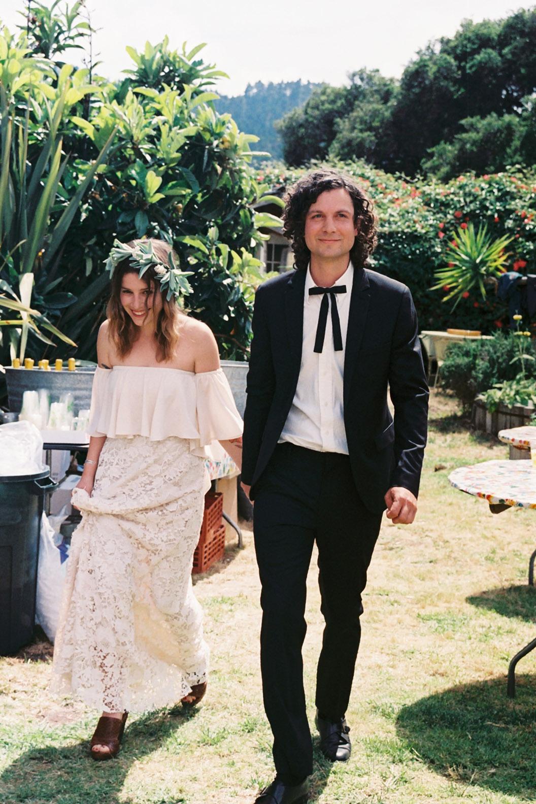 Renee and Miller walk into wedding party.jpg