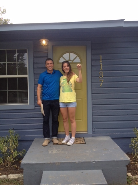My realtor, Henry, and I on closing day.