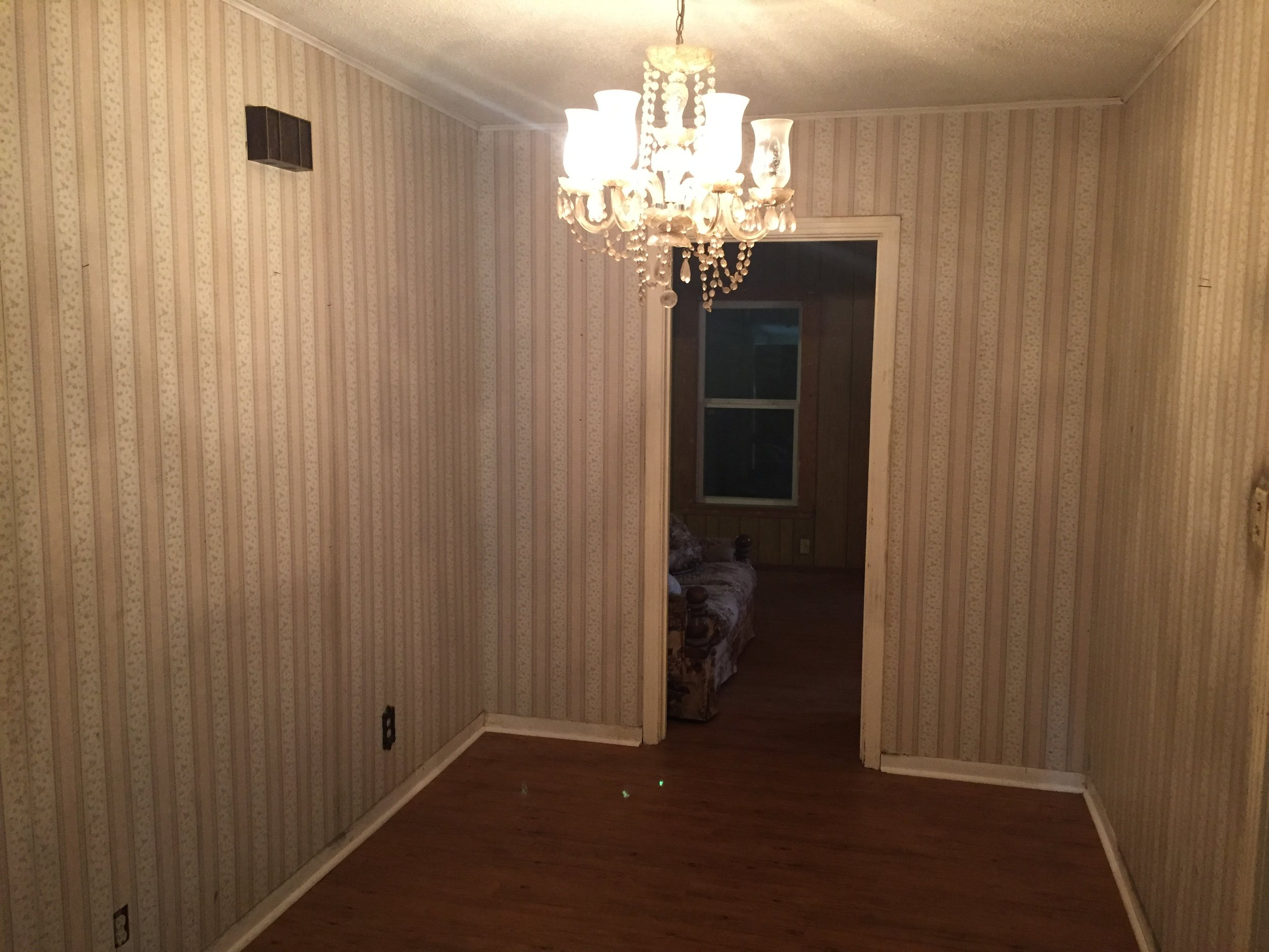 Dining Room Before - yikes wallpaper! Keeping the chandelier was better in theory than in practice.