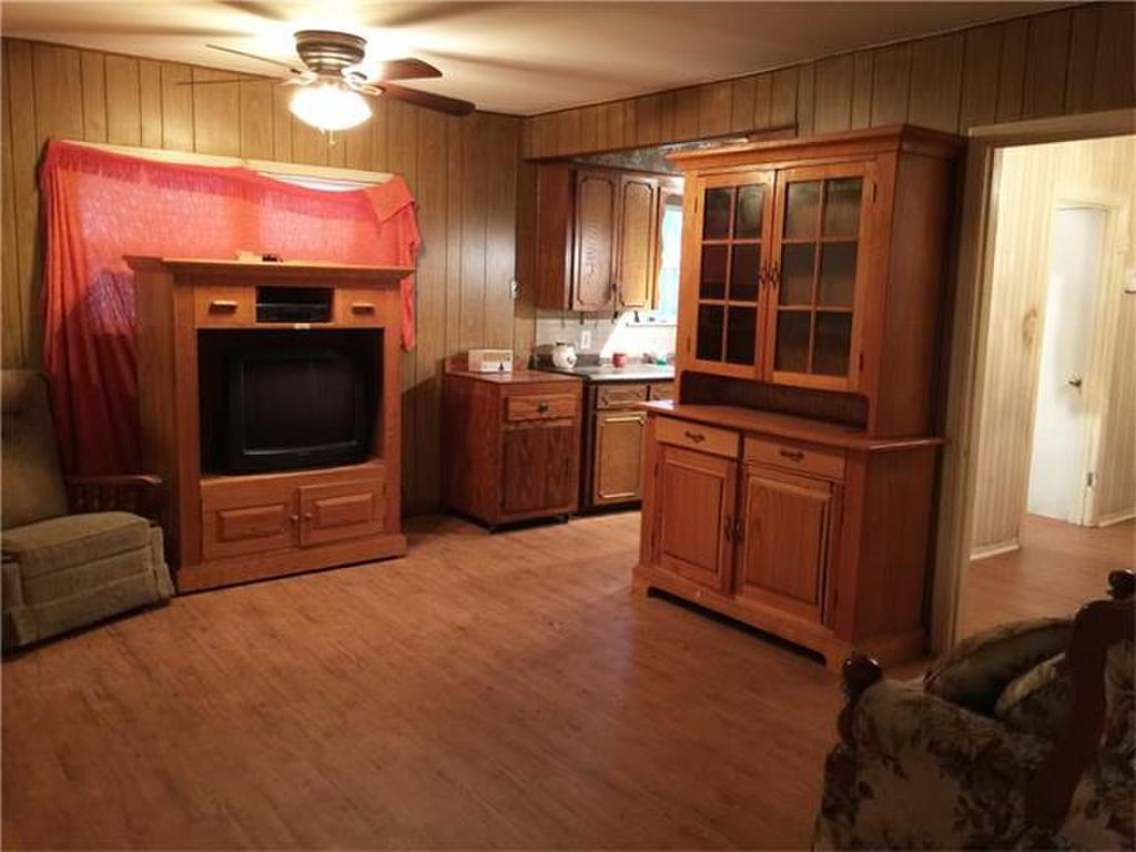Family Room Before - WOOD PANELING GALORE