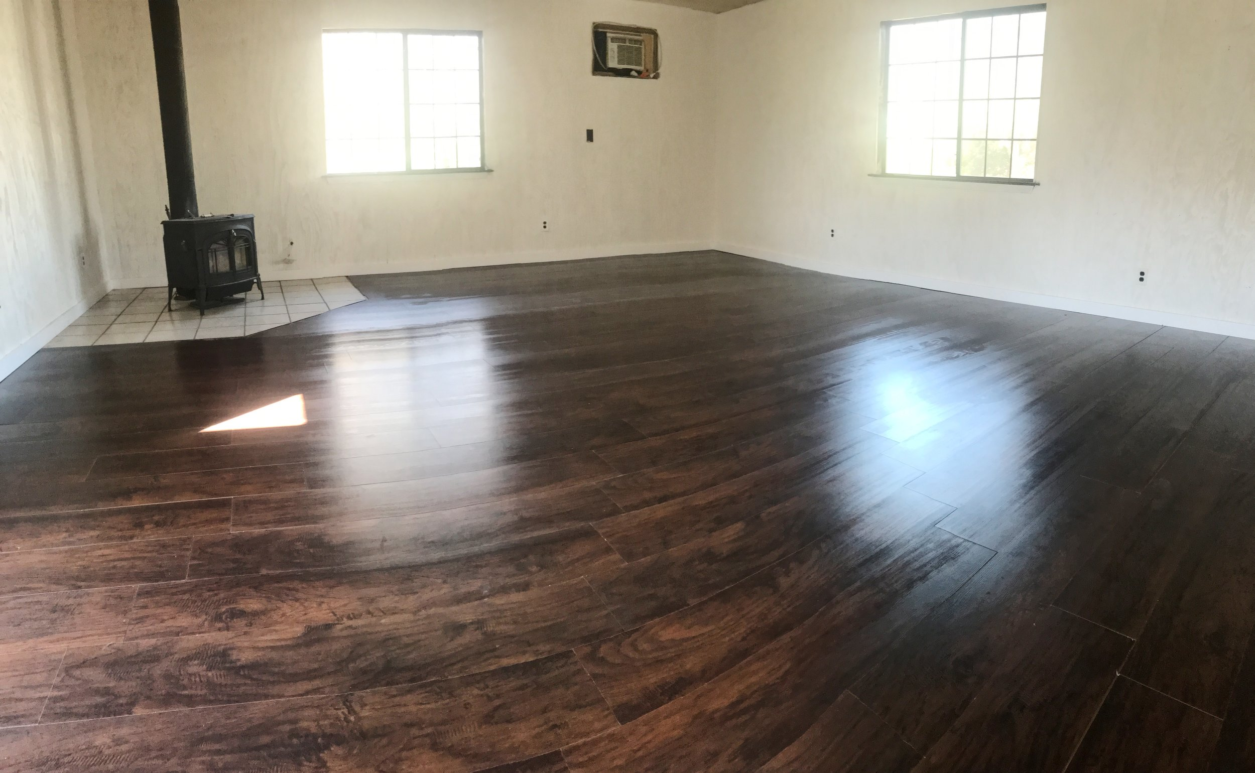 Laying wood laminate flooring saves a lot of money, but is a HUGE pain.