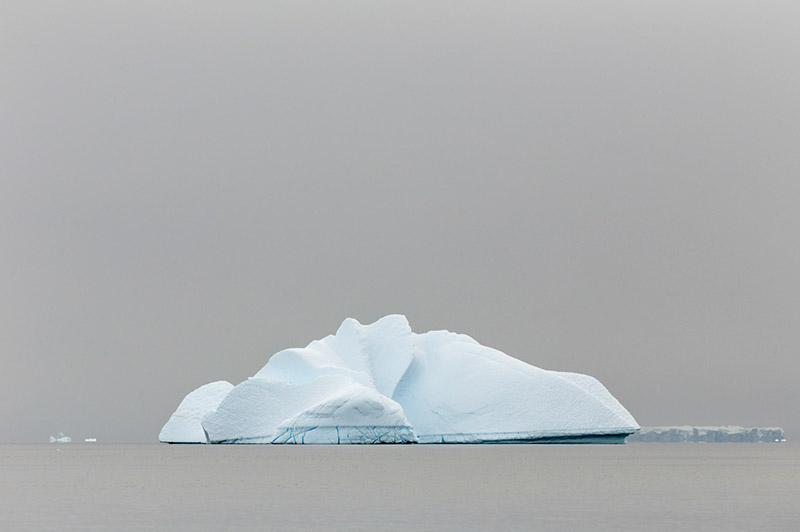 Iceberg in Fog. Arctowski Peninsula, Antarctica