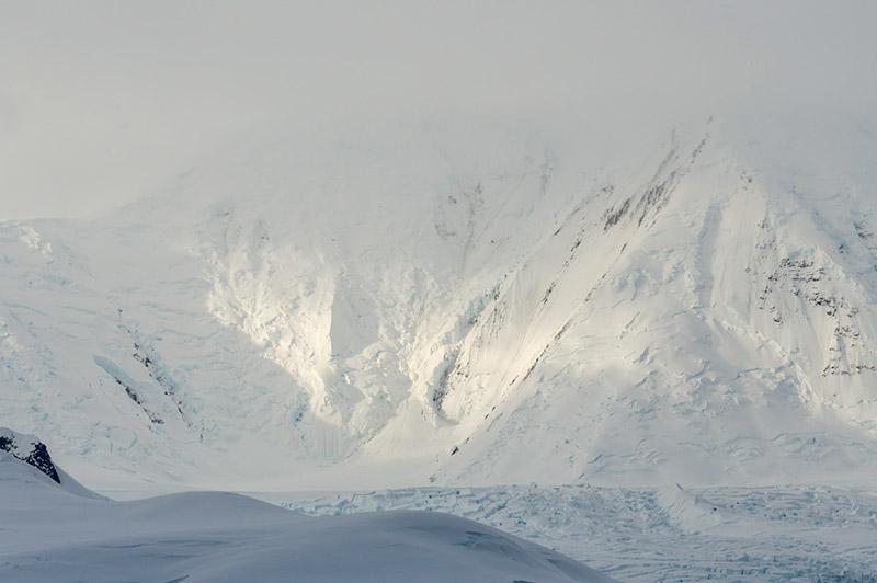 Sun Breaks on Mountain. Dallmann Fjords, Antarctica