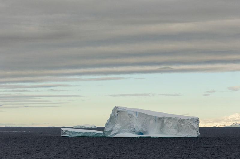 Iceberg Under Cloud. North of Antarctica