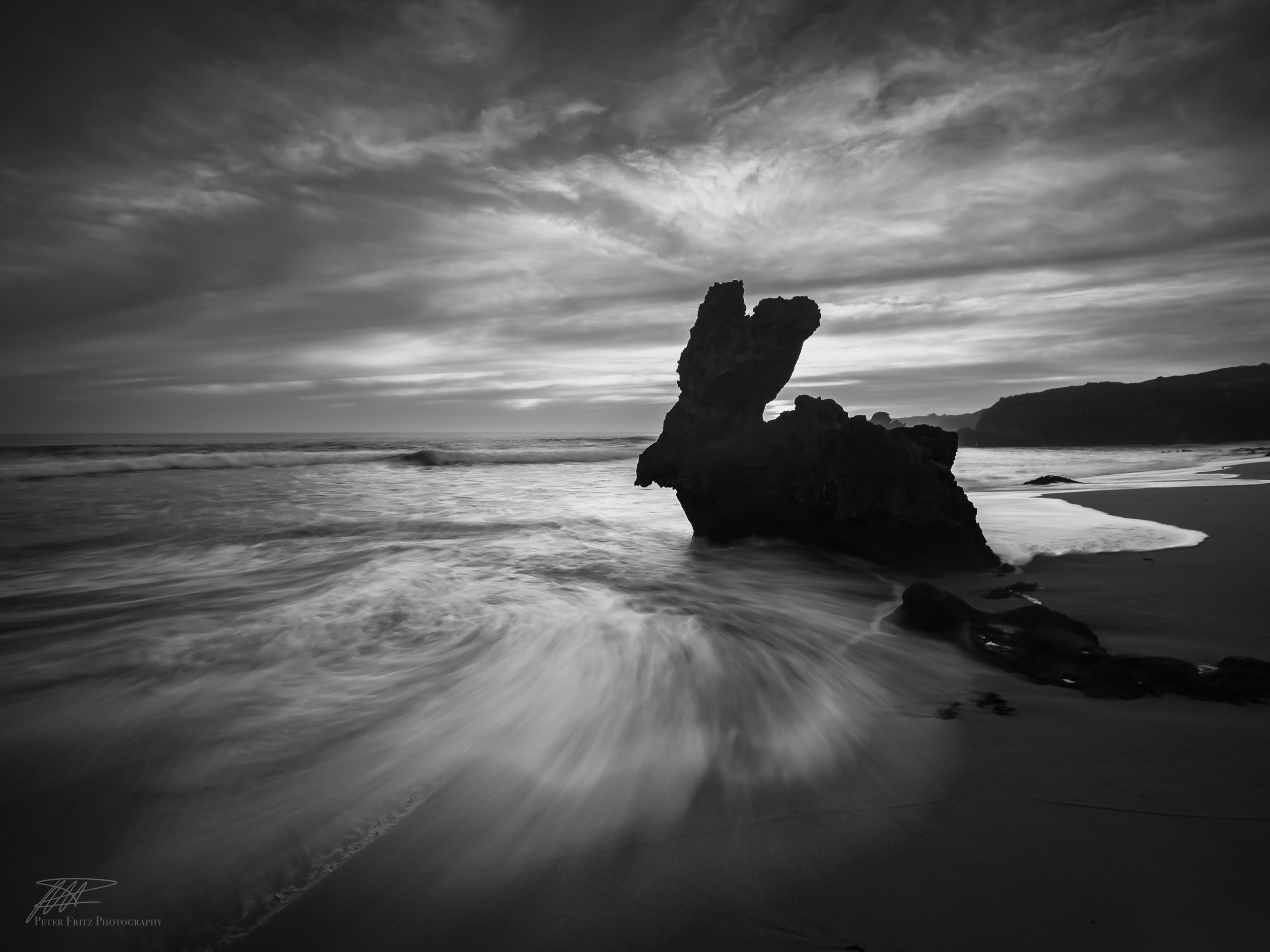 My black and white solution for poor sunsets which emphasises the rock and swirling water