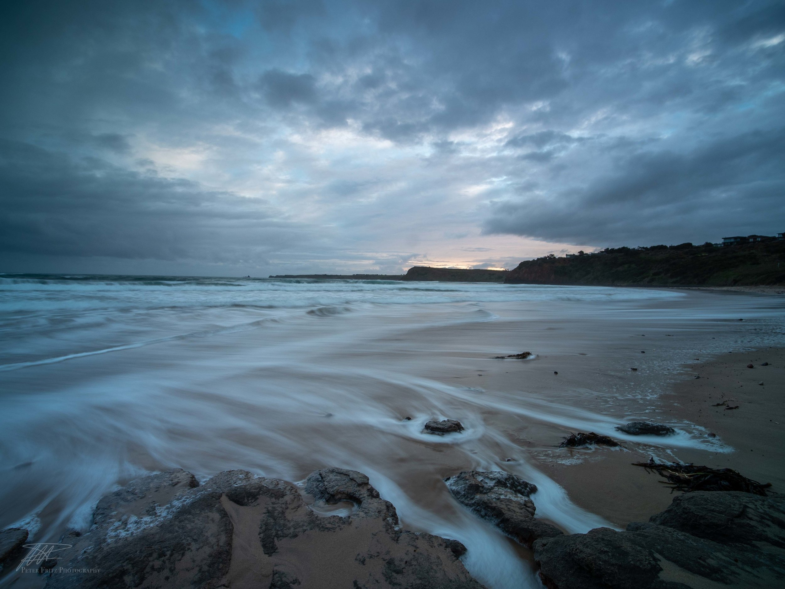A lacklustre sunset at Smiths Beach despite fantastic clouds and great movement in the water.