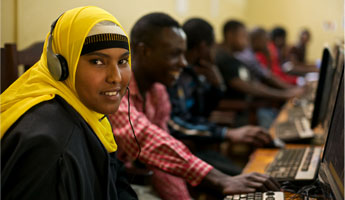 A Somali student participates in an online class at the JC:HEM center at the Dzaleka refugee camp in Malawi. (Photo via JRS, Giulio D'Ercole)
