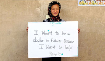 A young Afghani woman shares her dream of attending a university and becoming a doctor.(Photo via JRS, Bashir A. Behzad)