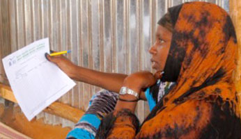 Somali woman at the Melkadida refugee camp prepares to conduct a community needs assessment.
