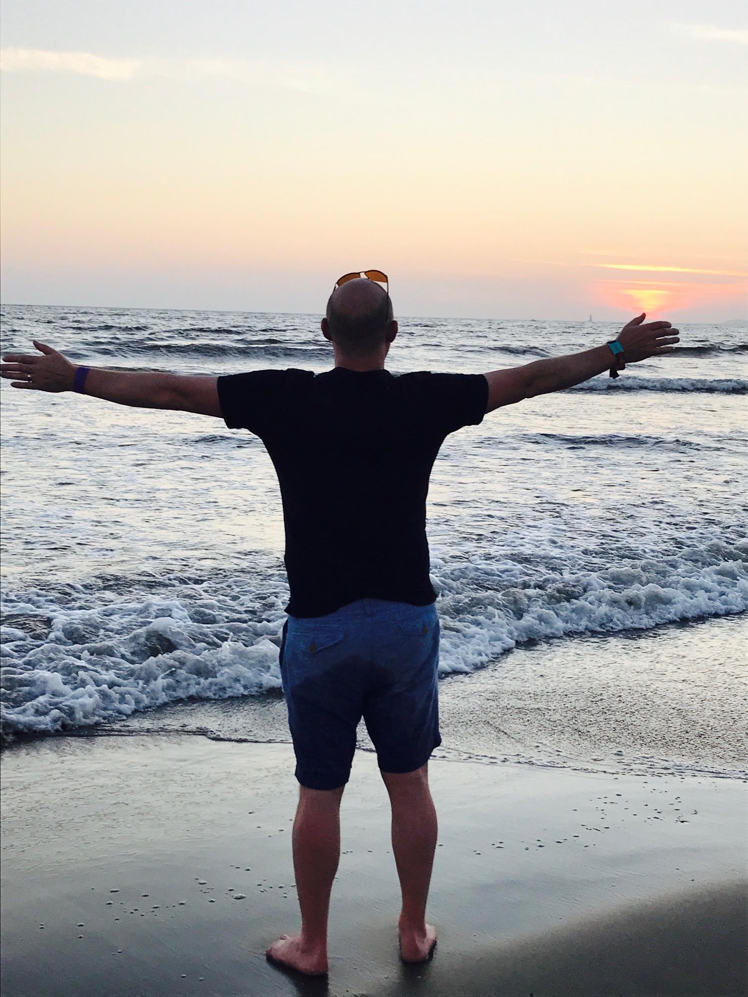 Jeremy holding onto the sunset