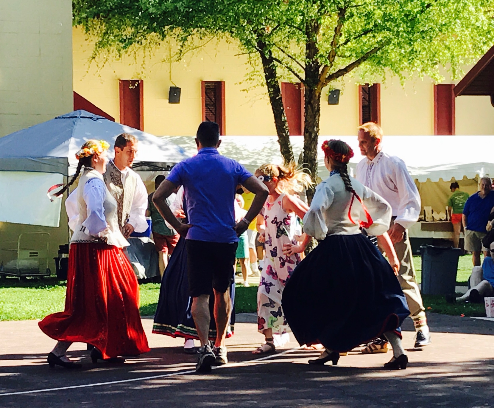 John (without traditional Latvian attire) dancing with Emi at the Latvian Festival