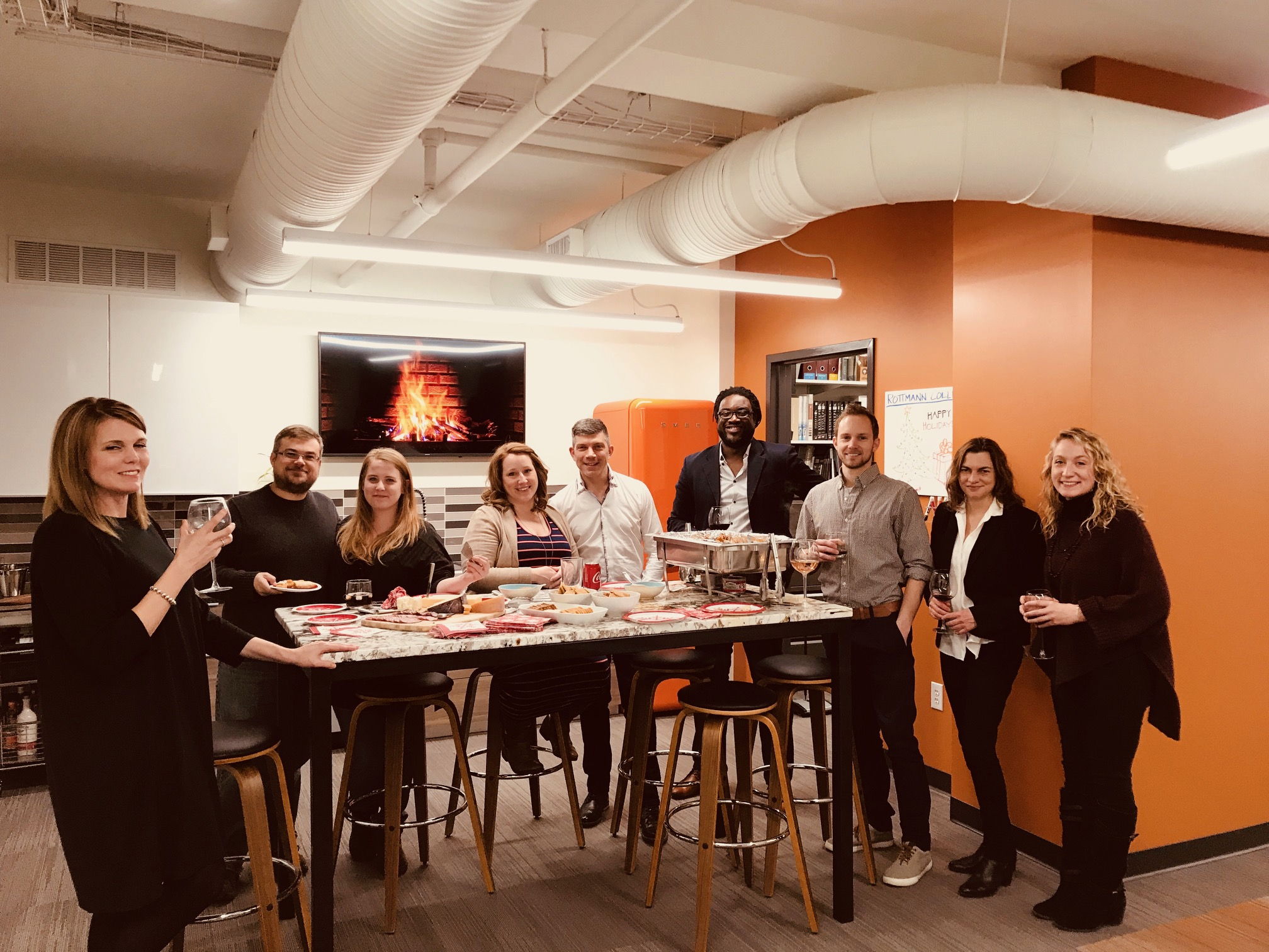 Rottmann Collier Pre-Holiday Dinner with cocktails at the office