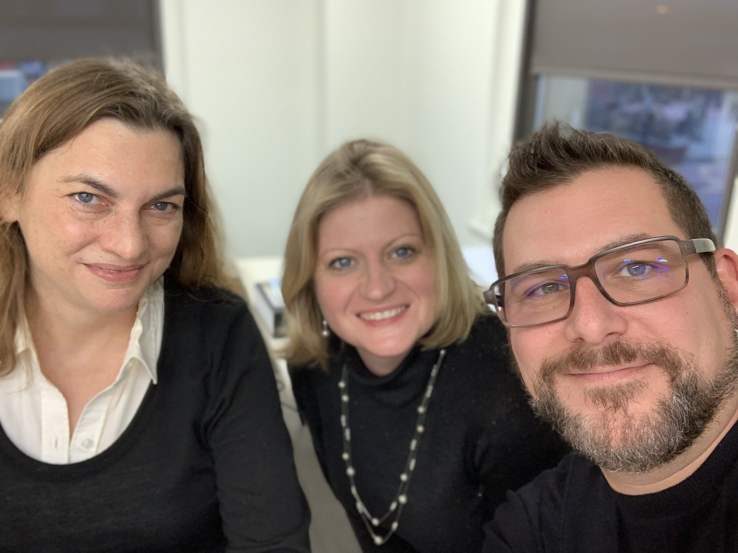 Sam, Megan, and I clowning around (all in black) in the office.