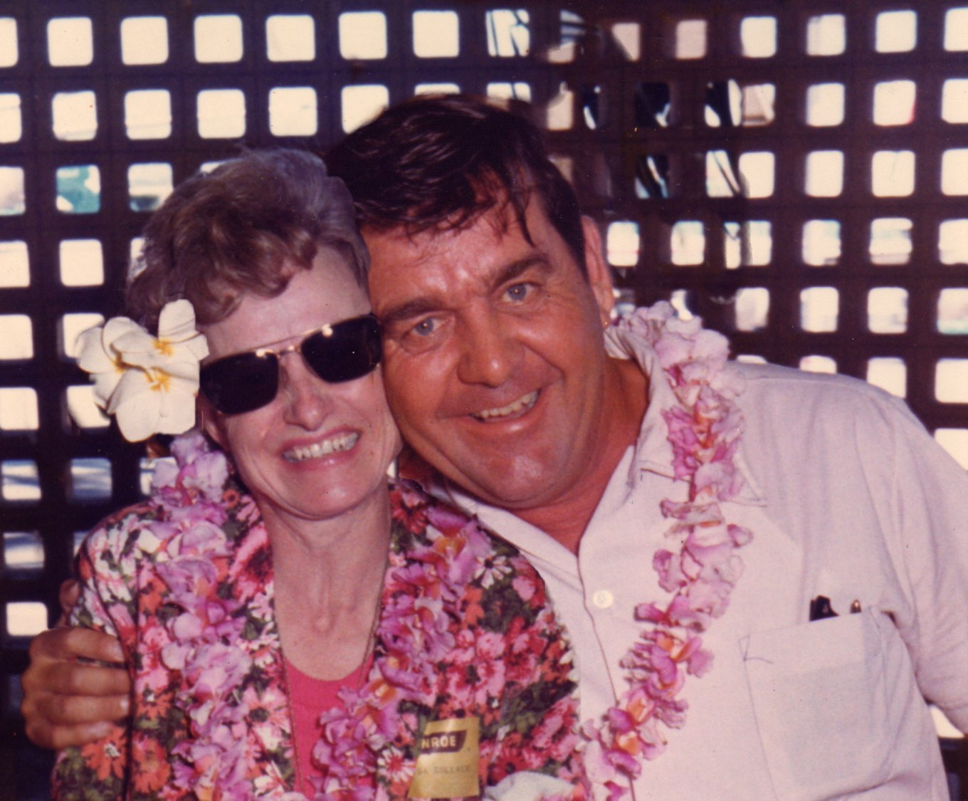 """This photo actually never existed. When they went to Hawaii on their 25th Anniversary, they were greeted by [and photographed with] a local man and woman. I took the man and woman out of the original photos and photoshopped Grandma and Grandpa together into one photo. I wish you could have seen Grandma's face when I showed her this photo. She said, """"I've never seen that photo before- where did you find it?"""""""