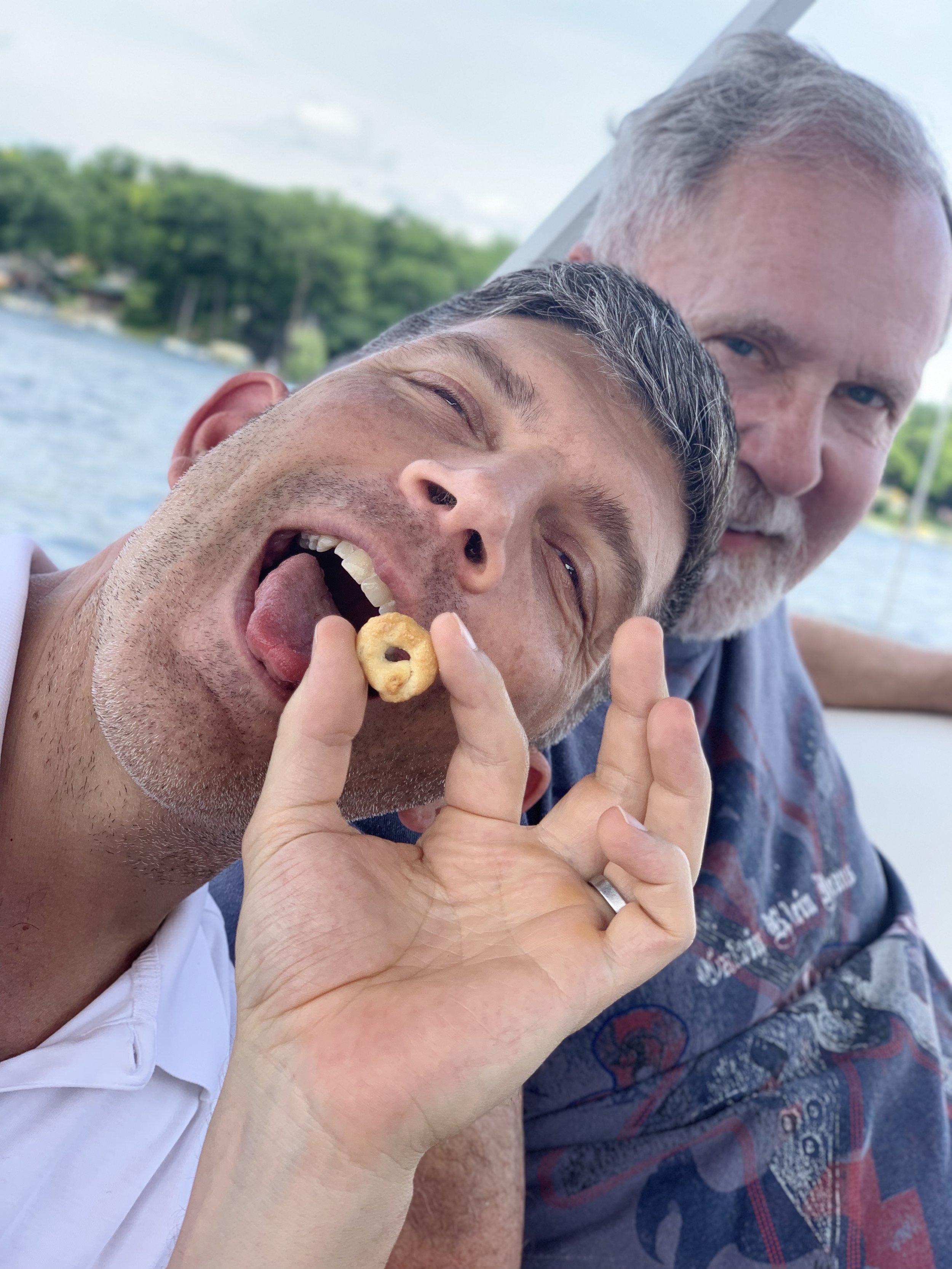 John and Scott eating Italian snacks