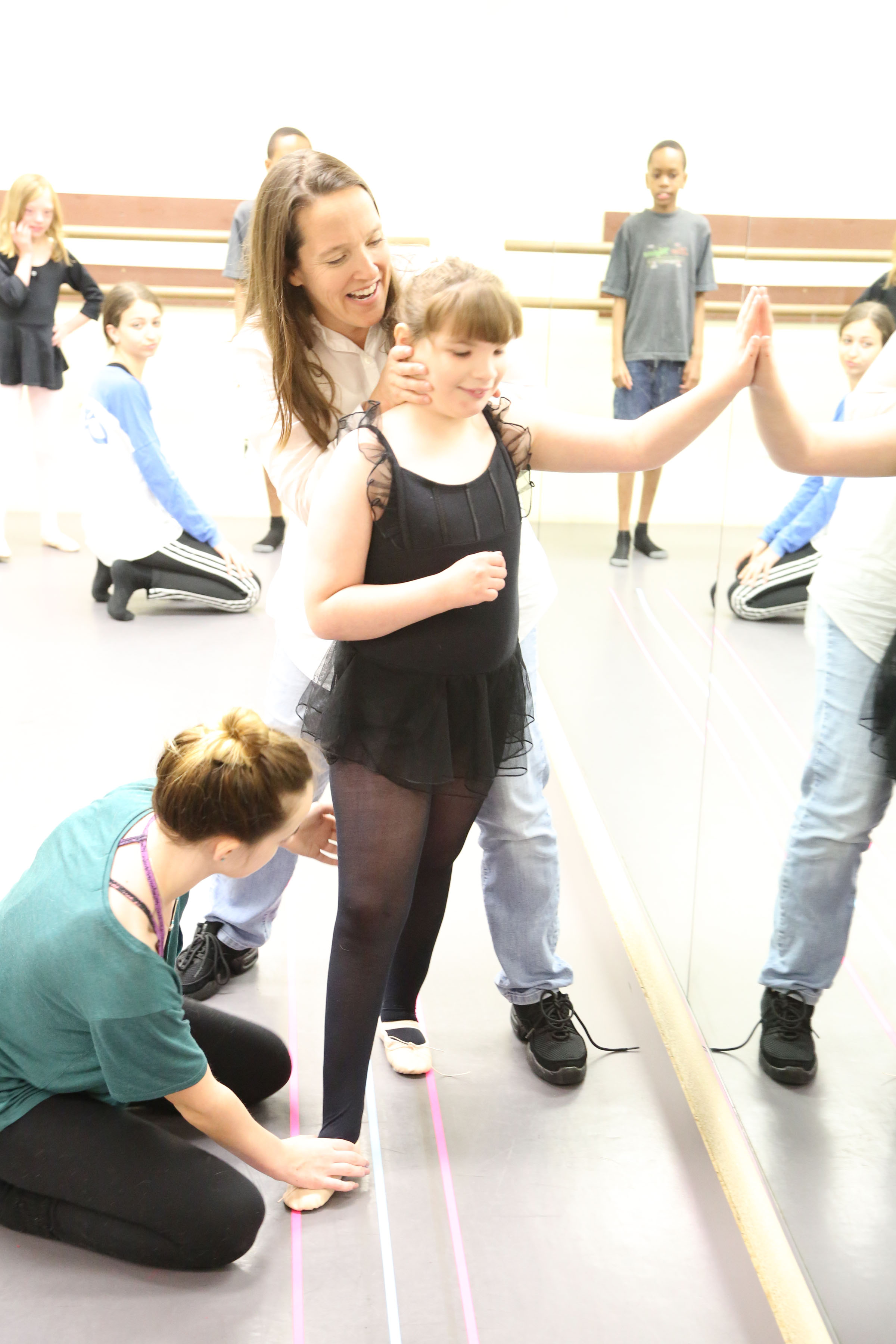 Students learning ballet walk and proper turnout.