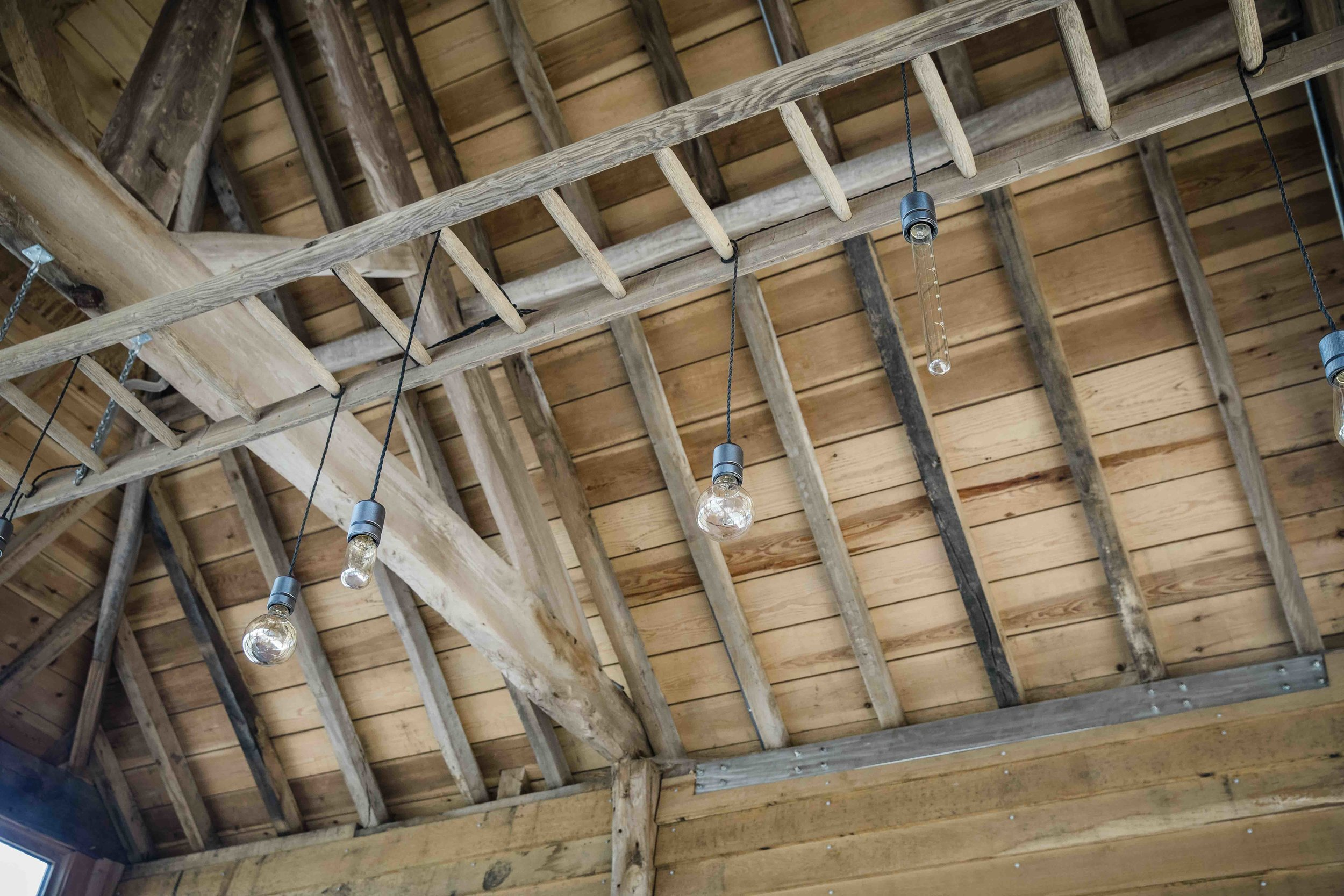 Lights hanging from roof of Hanley Hall Cartshed for web.jpg