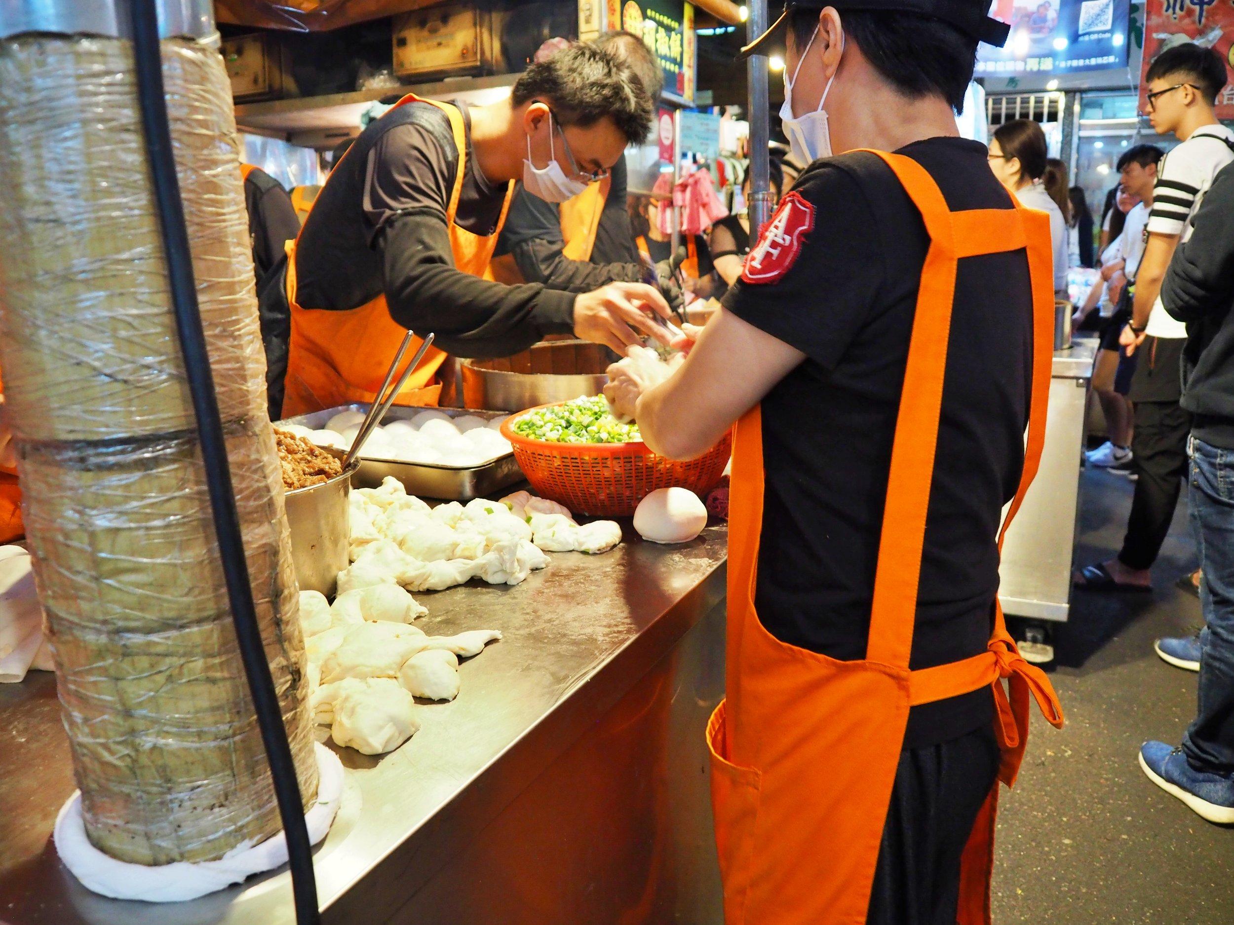 Vendors wearing face masks and everything at Ruifang night market in Taiwan