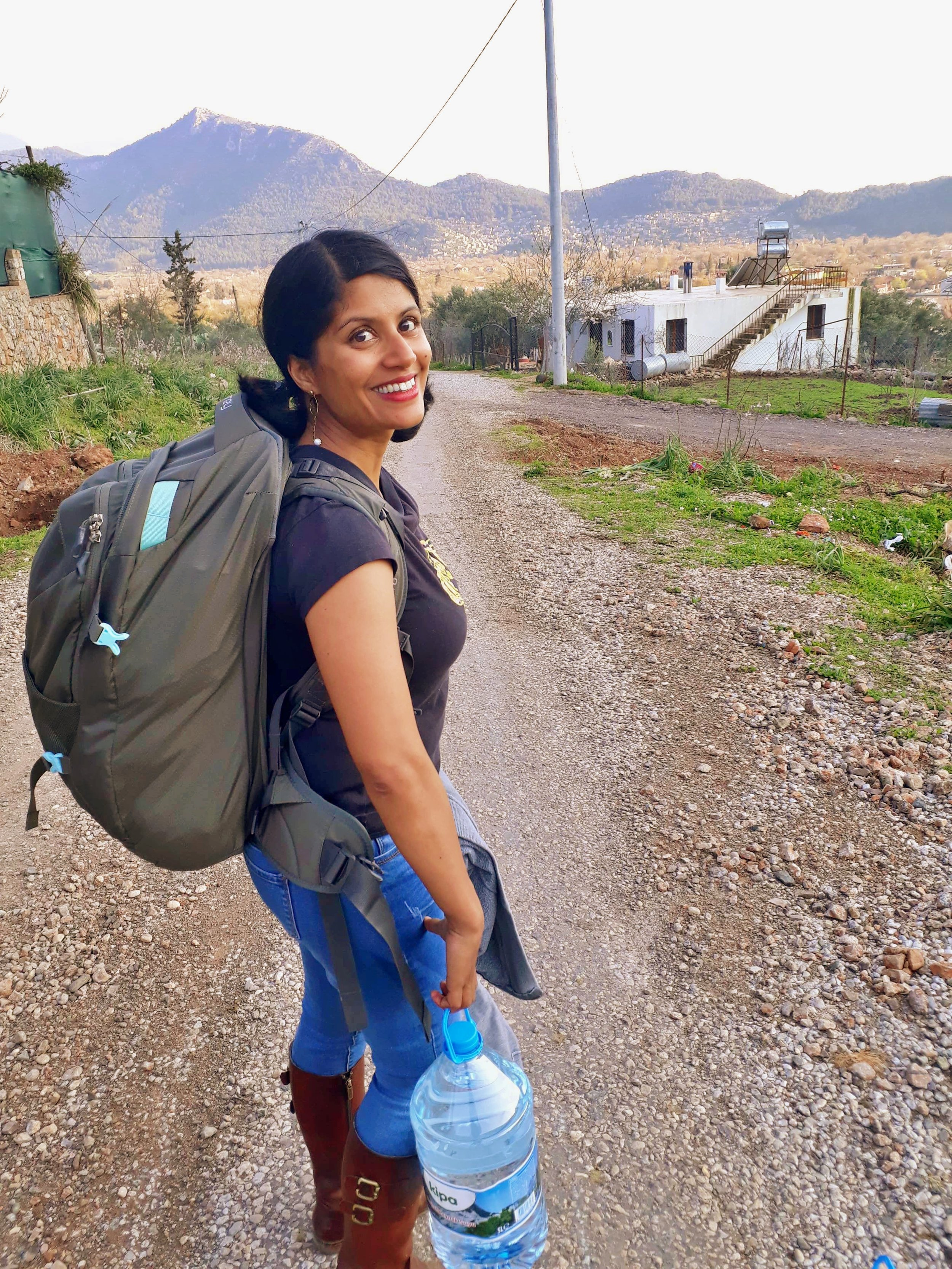 Still smiling despite the fact that it feels like I am carrying all the world's food on my back. The reality of village life with no car in Turkey.