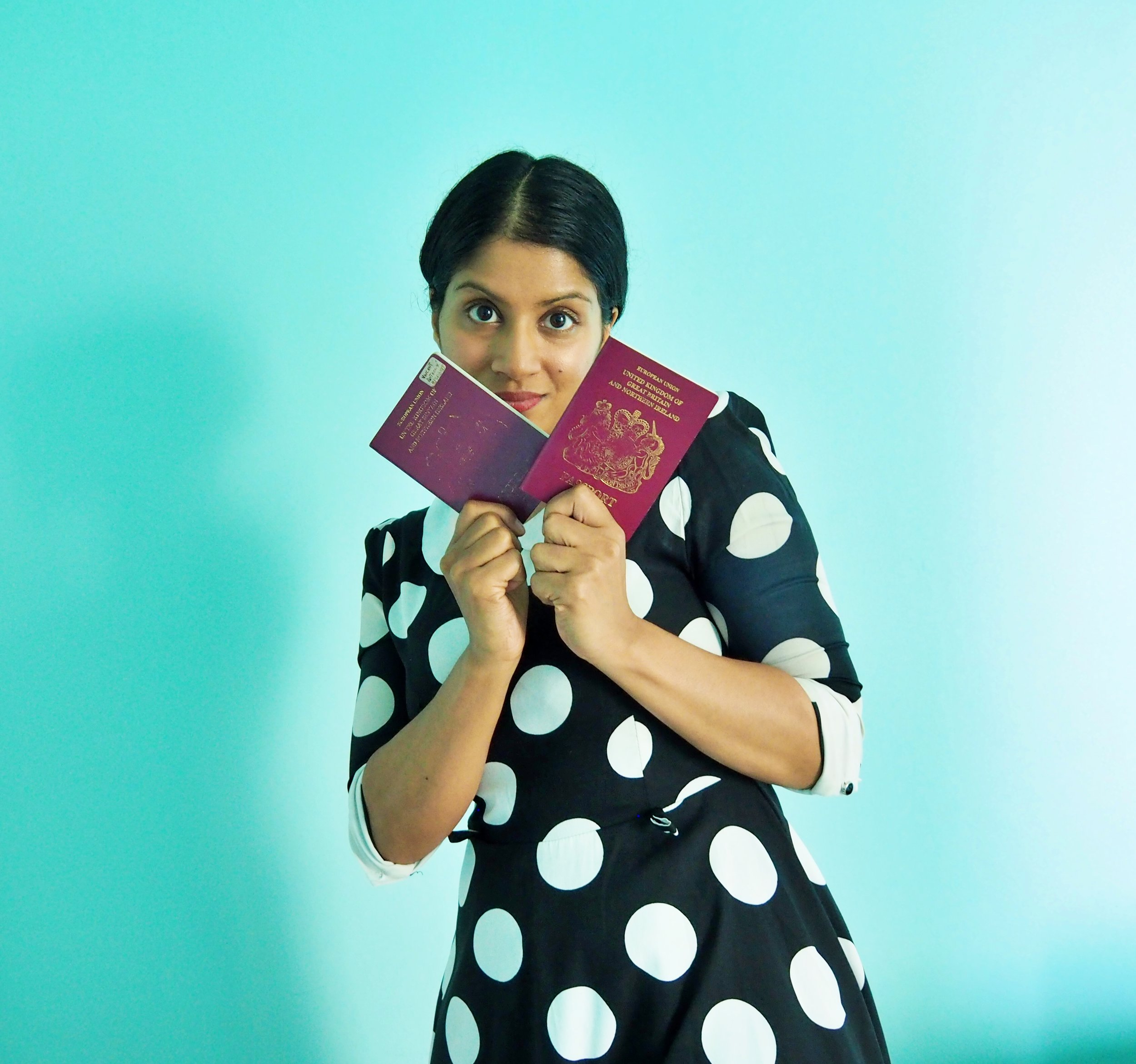 Newflash! I am BROWN and I have a British passport! (Okay, technically in this photograph I have two, but anyway, that isn't the point I am trying to make here).