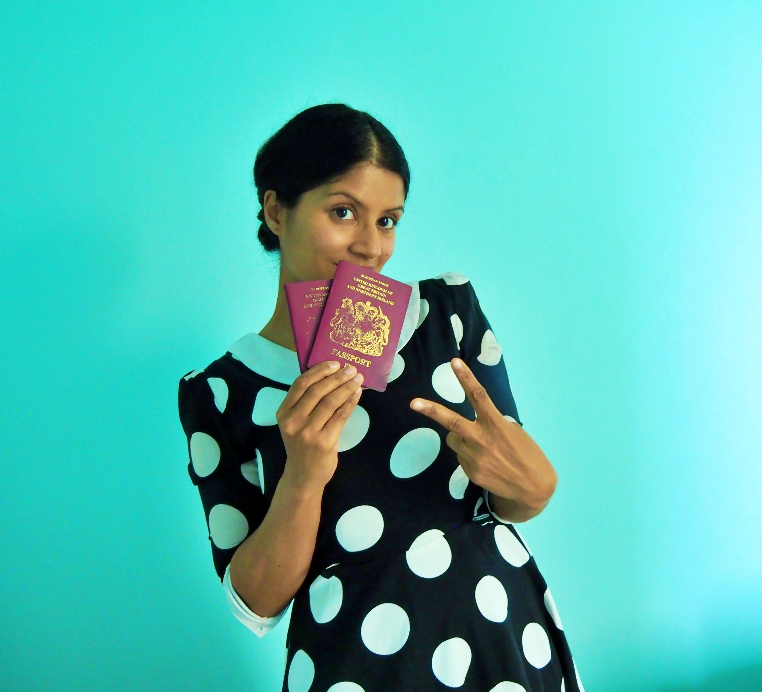 TRAVELLING WHILE BROWN PASSPORTS v sign.jpg